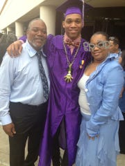 Vanderbilt football player LaDarius Wiley, center, poses at his high school graduation with his father, Lincoln Sr., and mother Sue. Lincoln Wiley Sr., died on Nov. 2, 2018, during LaDarius' senior season with the Commodores.