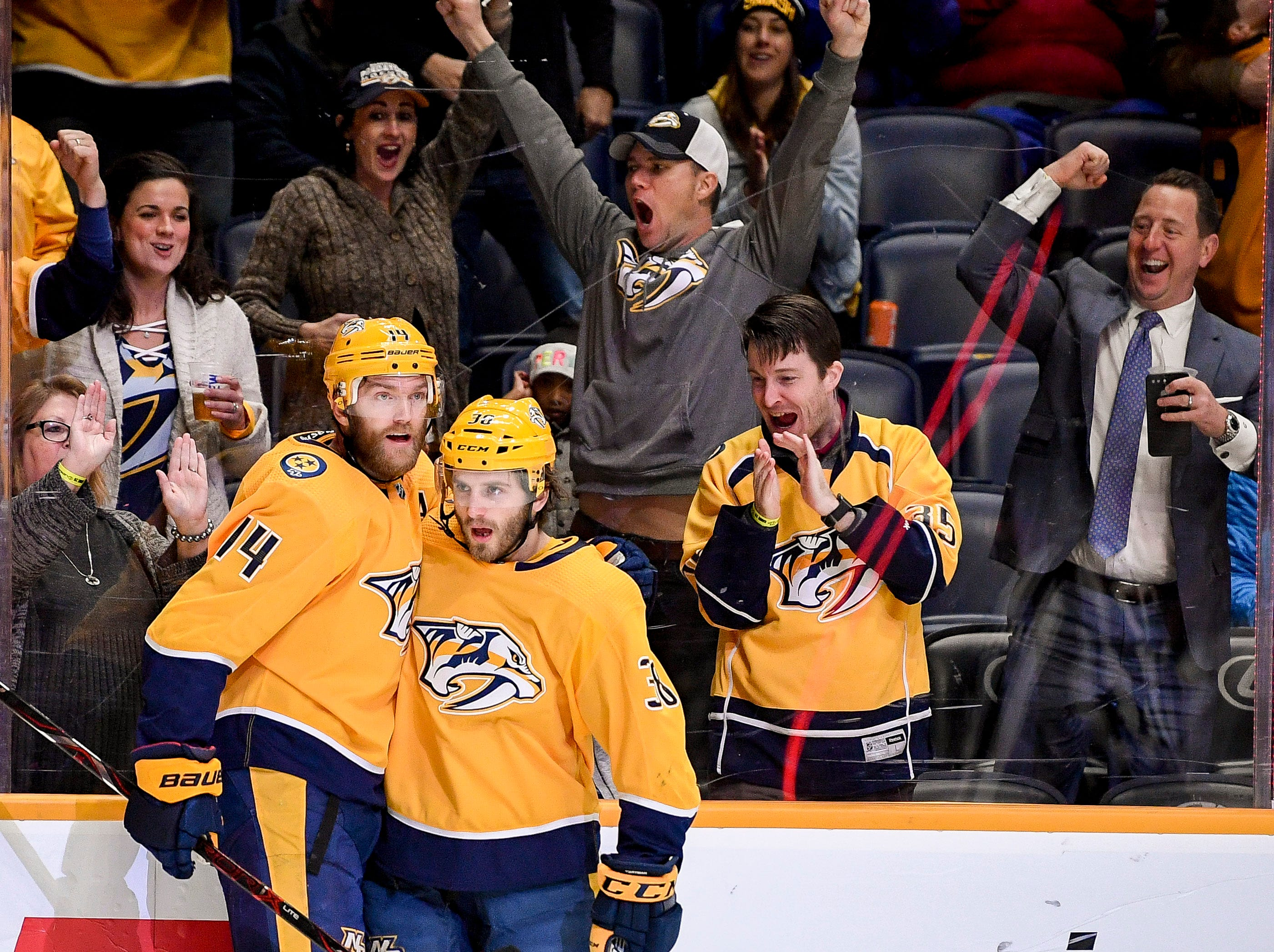 Nashville Predators right wing Ryan Hartman (38) celebrates his goal against the Vancouver Canucks with defenseman Mattias Ekholm (14) during the first period at Bridgestone Arena in Nashville, Tenn., Thursday, Dec. 13, 2018.