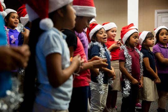 Children from the Gargiulo Education Center in North Naples sing Christmas carols to residents of nearby Juniper Village on Friday, Dec. 14, 2018.