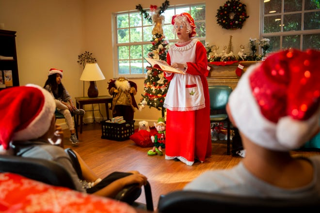 "Diana Chagnon reads ""How the Grinch Stole Christmas!"" to children from Gargiulo Education Center while dressed as Mrs. Claus on Friday, Dec. 14, 2018, at Juniper Village in Naples."