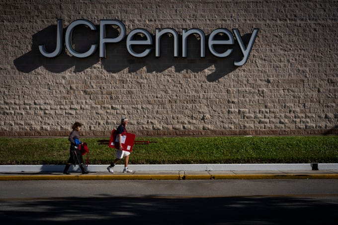 Salvation Army route manger, Allen Wetenkamp escorts Naples Daily News reporter, Harriet Heithaus, to her designated location at the J.C. Penney back entrance at Coastland Center on Nov. 28, 2018.