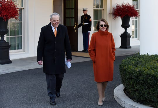House Minority Leader Nancy Pelosi and Senate Minority Leader Charles Schumer walk out of the West Wing after a meeting with President Donald Trump at the White House on Tuesday.