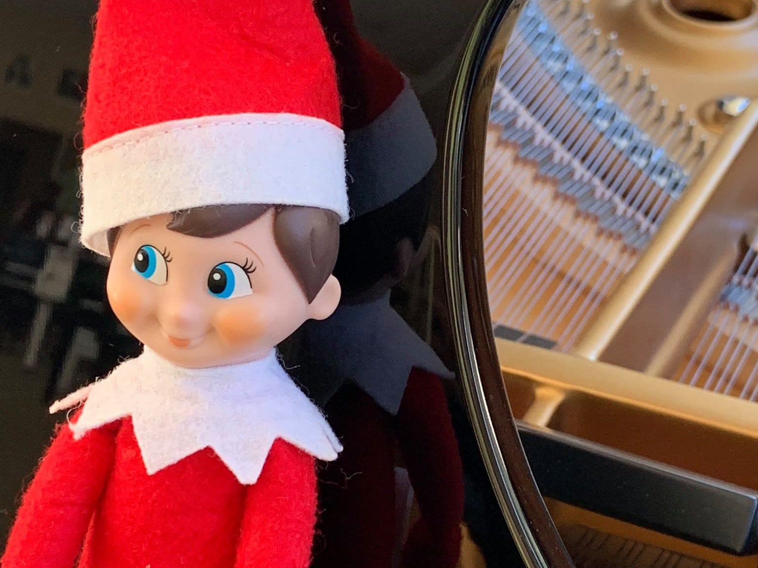Chauncey the Elf from the Bonita Springs Area Chamber of Commerce visits member businesses every December. Here is Chauncey at Steinway Piano Gallery.
