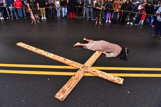 Actor Justin Carrasco, 21, who plays the role of Jesus plays out a scene of the Passion Play - a depiction of the Passion of Jesus Christ: his trial, suffering and death, played on the streets of Paterson on Good Friday, March 30, 2018