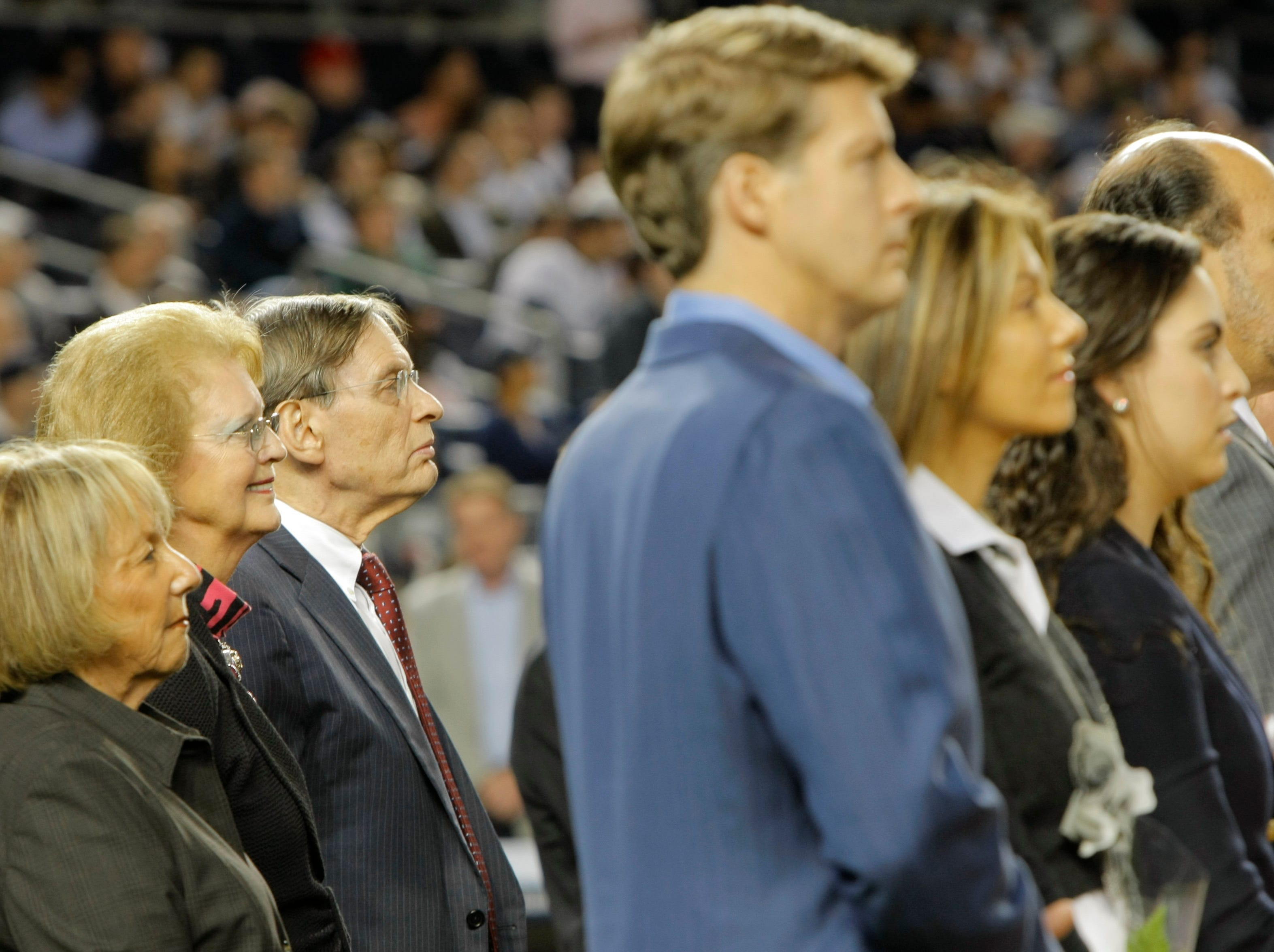 Standing at home plate during a ceremony to honor the Yankees late owner George Steinbrenner are, far left  to right, Sue Selig, wife of baseball commissioner Bud Selig, George's widow Joan Steinbrenner and Bud Selig before the MLB game between the New York Yankees and Tamp Bay Rays at Yankee Stadium. In the foreground in the blue jacket is Hal Steinbrenner one of George's sons and the managing general partner. 9/20/10 Bronx, NY (John Munson/The Star-Ledger)
