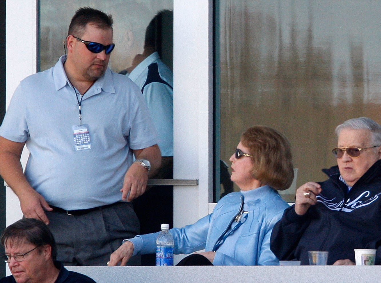 A security guard talks with Joan Steinbrenner as she sits with her husband, George Steinbrenner, right, the Yankees' chairman and principal owner, in the family's private box as they watched the Yankees defeat the Philadelphia Phillies 7-5 in a spring training baseball game at Steinbrenner Field in Tampa, Fla., Monday, March 8, 2010.