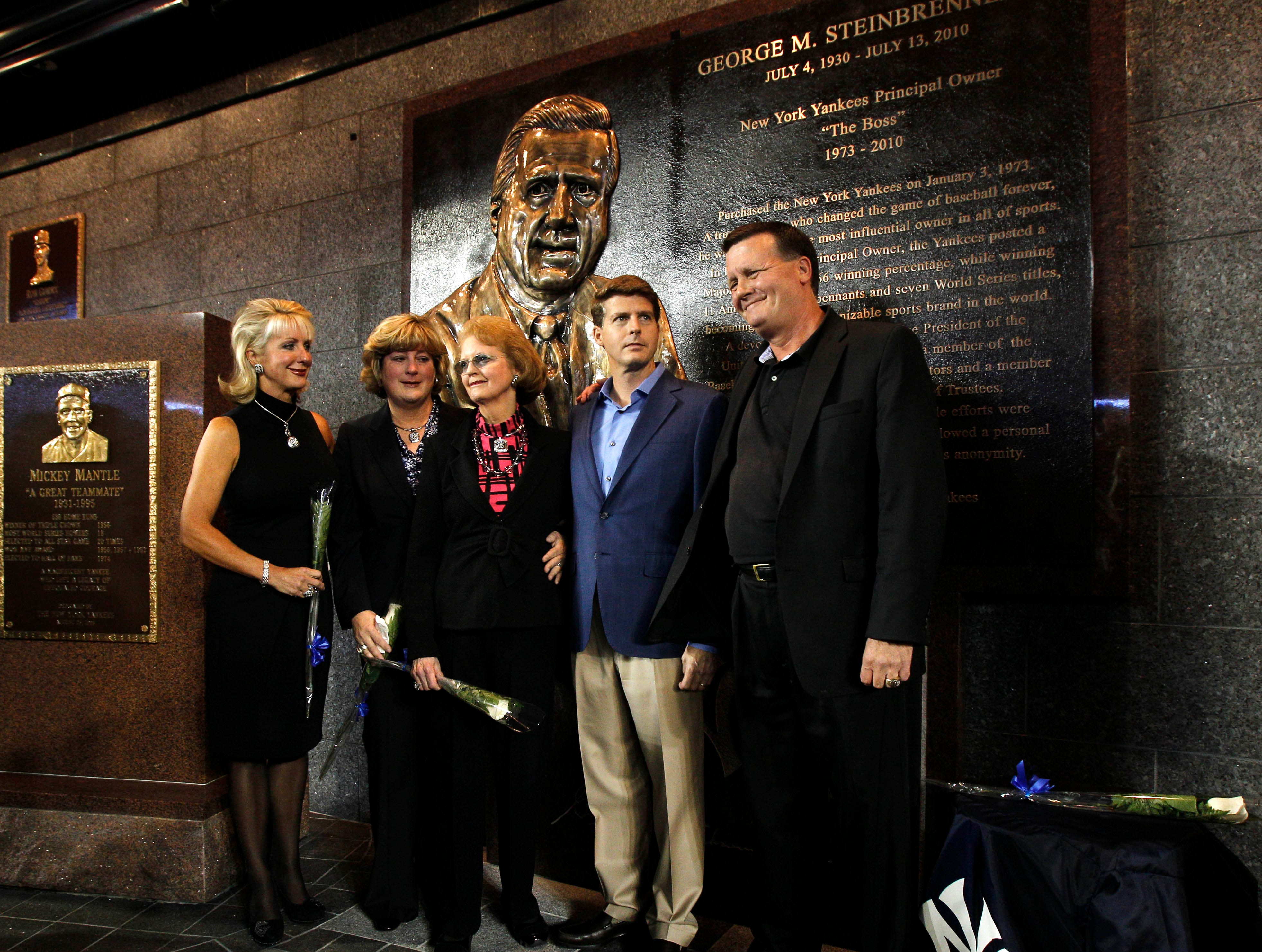 Members of George Steinbrenner's family pose for photographers following a ceremony dedicating a monument to the late Yankees owner, before the Yankees' baseball game against the Tampa Bay Rays at Yankee Stadium in New York, Monday, Sept. 20, 2010. From left are daughters Jennifer Steinbrenner Swindal and Jessica Steinbrenner; widow Joan Steinbrenner; and sons Hal and Hank Steinbrenner. (AP Photo/Kathy Willens, Pool)