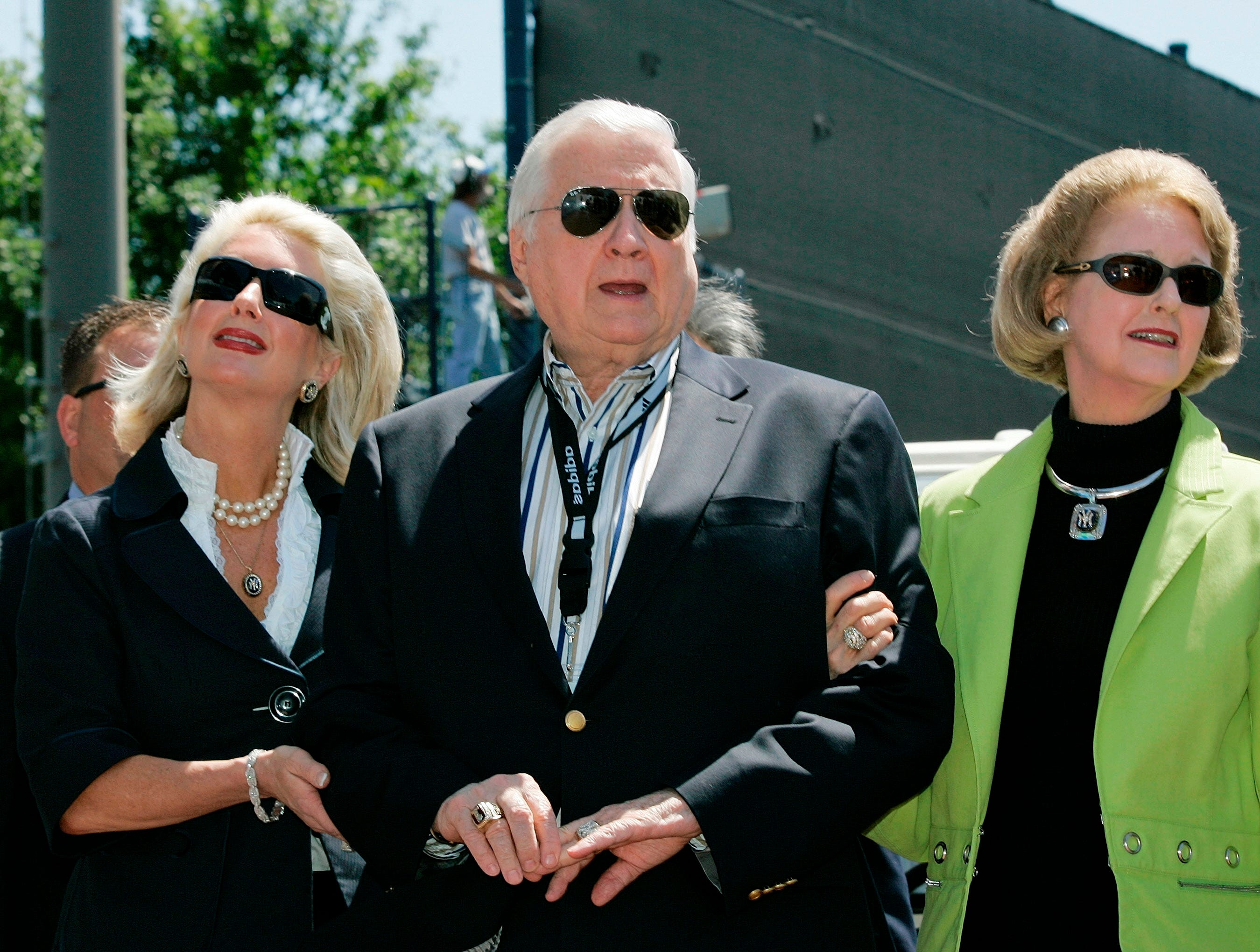 In this March 27, 2008 file photo, New York Yankees senior vice president for new stadium public affairs Jennifer Steinbrenner Swindal, left, holds onto her father and Yankees principal owner George Steinbrenner, center, along with his wife, Joan, during a pregame ceremony renaming Legends Field to George  M. Steinbrenner Field at spring training baseball, in Tampa, Fla.