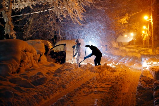 Residents on Mills Street in Morristown dig out their car after a nor'easter dumped over a foot of snow around the area. March 7, 2018.  Morristown, NJ.