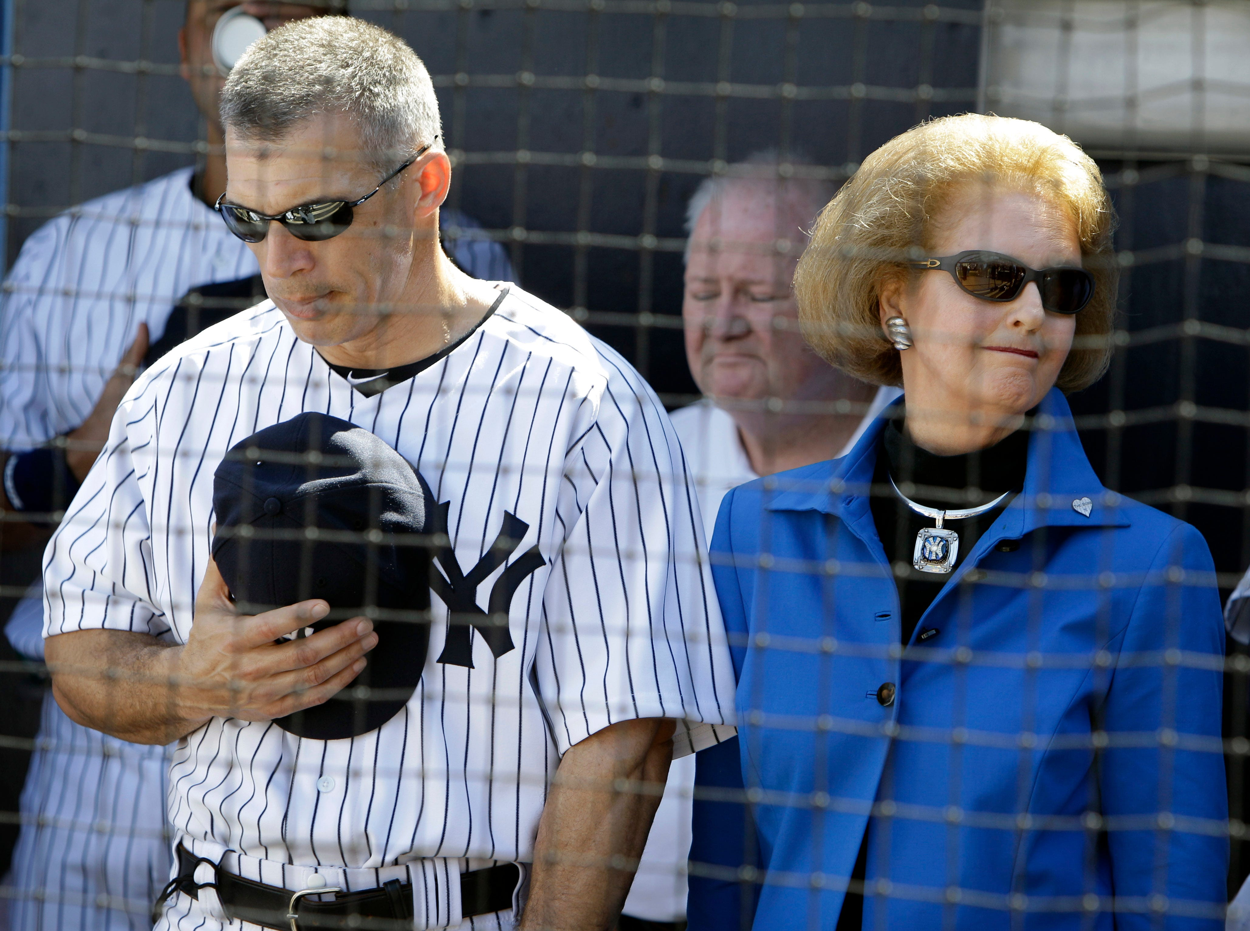 New York Yankees manager Joe Girardi stands with Joan Steinbrenner during a tribute for her husband the late George Steinbrenner before a baseball spring training game against the Philadelphia Phillies Saturday, Feb. 26, 2011, at Steinbrenner Field in Tampa, Fla. (AP Photo/Charlie Neibergall)