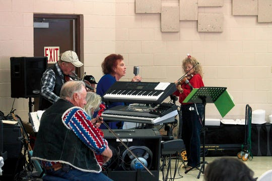 In this 2014 file photo, a group of musicians performed Christmas songs during Tularosa's Christmas Day meal at the Community Center.