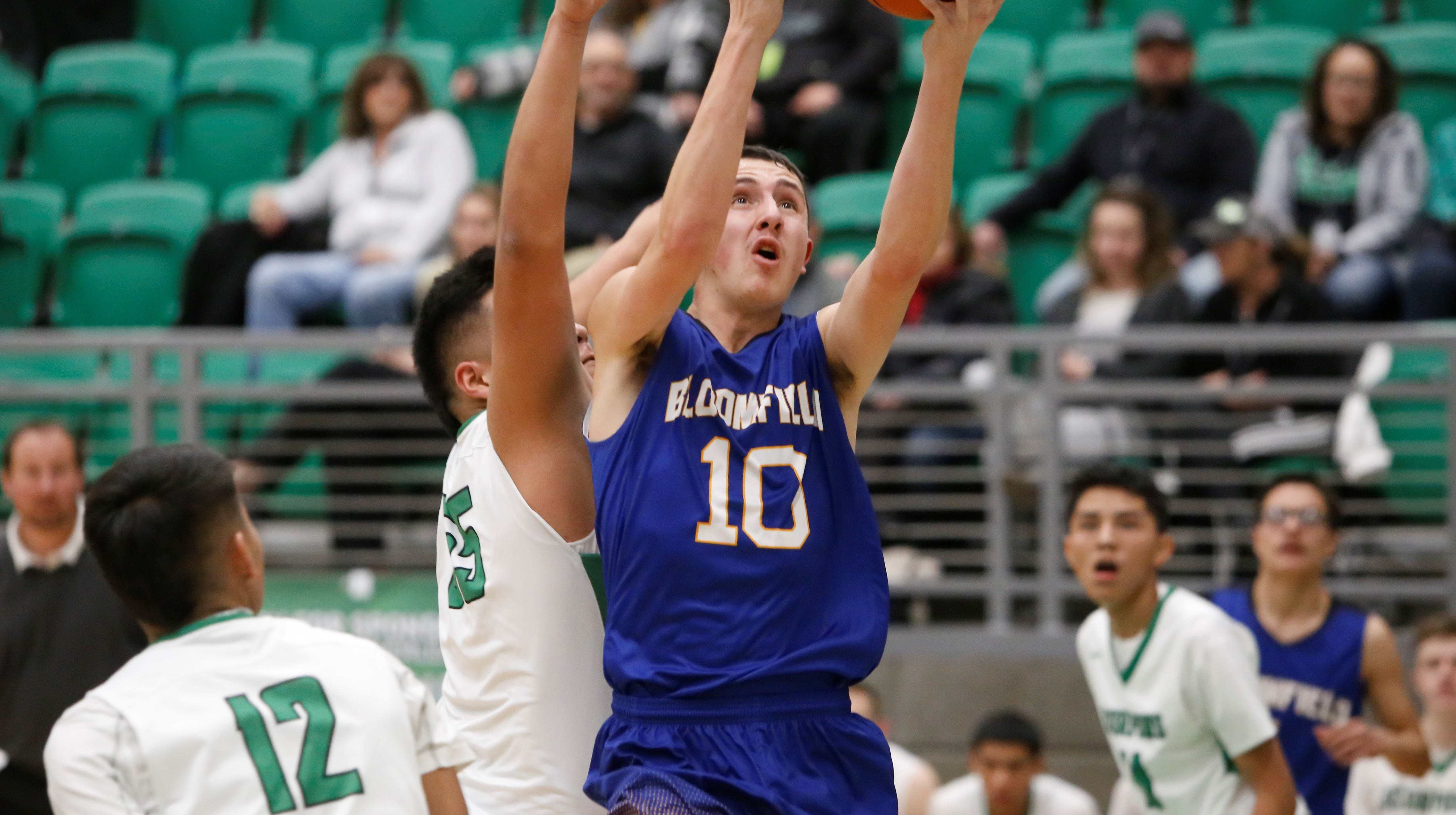 Bloomfield's Josh Boehm drives to the basket for a layup against Farmington during Thursday's game at Scorpion Arena in Farmington.