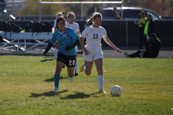 Navajo Prep's Kylie Begay, left, and Rehoboth Christian's Kora Zylstra battle for possession of the ball during the A-3A girls soccer playoff opener Saturday, Nov. 3 at Eagle Stadium in Farmington. Begay, who made the A-3A All-State first team, is among seven Lady Eagles players to earn All-State honors.
