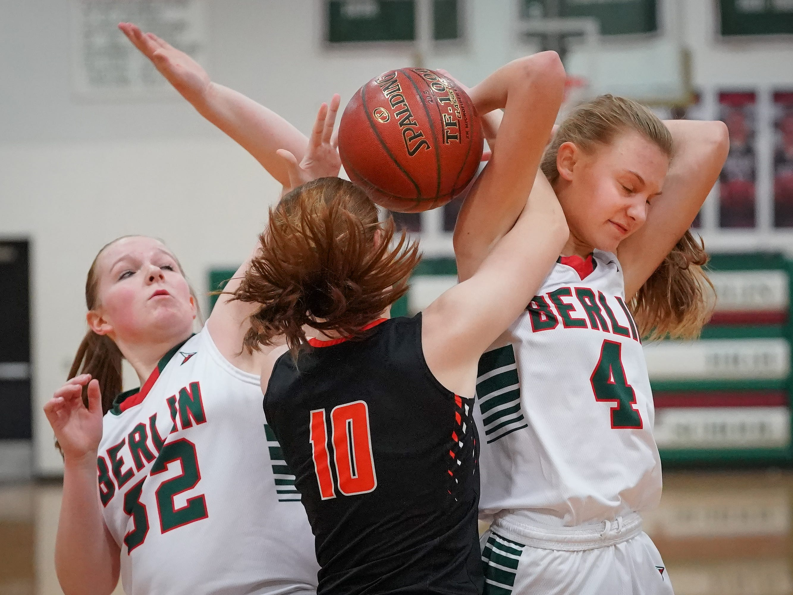 Hana Goeser (10) of Plymouth battles Jenna Sternitske (32) and Olivia Bartol (4) of Berlin for the ball. The Berlin Indians hosted the Plymouth Panthers in an East Central Conference basketball game Thursday evening, December 13, 2018.