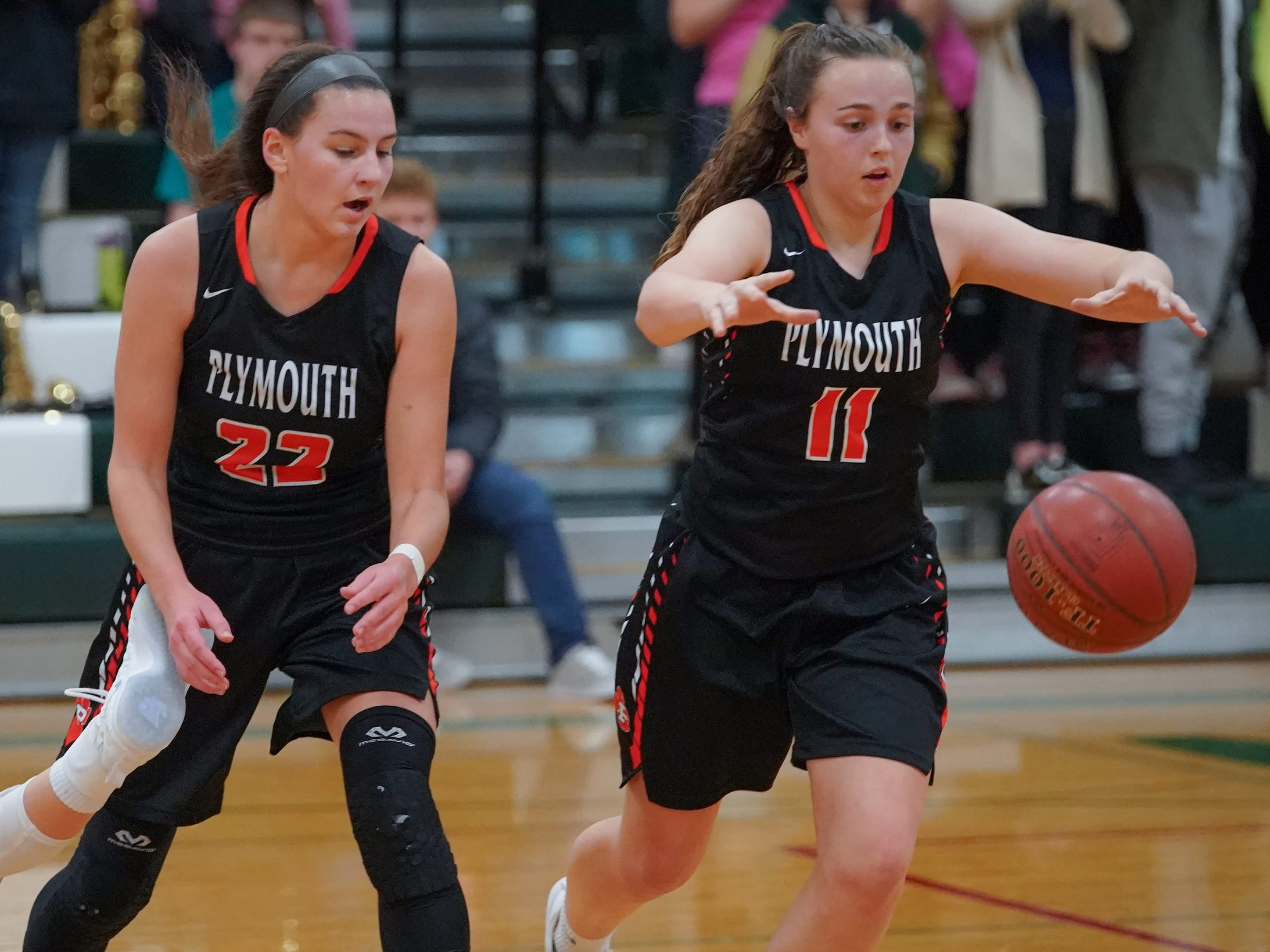 Addie Plate (11) of Plymouth reaches for a loose ball. The Berlin Indians hosted the Plymouth Panthers in an East Central Conference basketball game Thursday evening, December 13, 2018.
