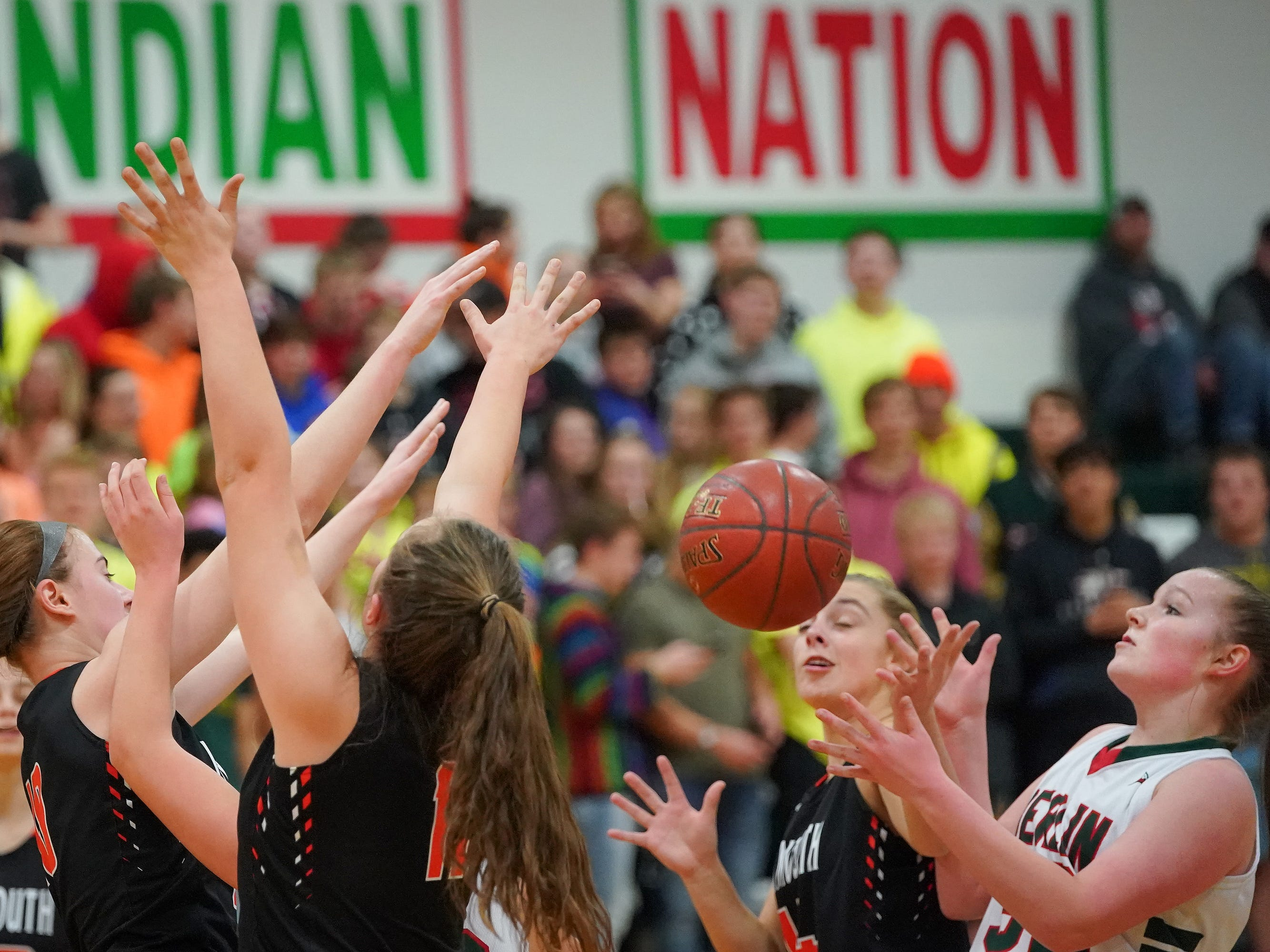 A battle for a rebound sends the ball toward Jenna Sternitske (32) of Berlin. The Berlin Indians hosted the Plymouth Panthers in an East Central Conference basketball game Thursday evening, December 13, 2018.