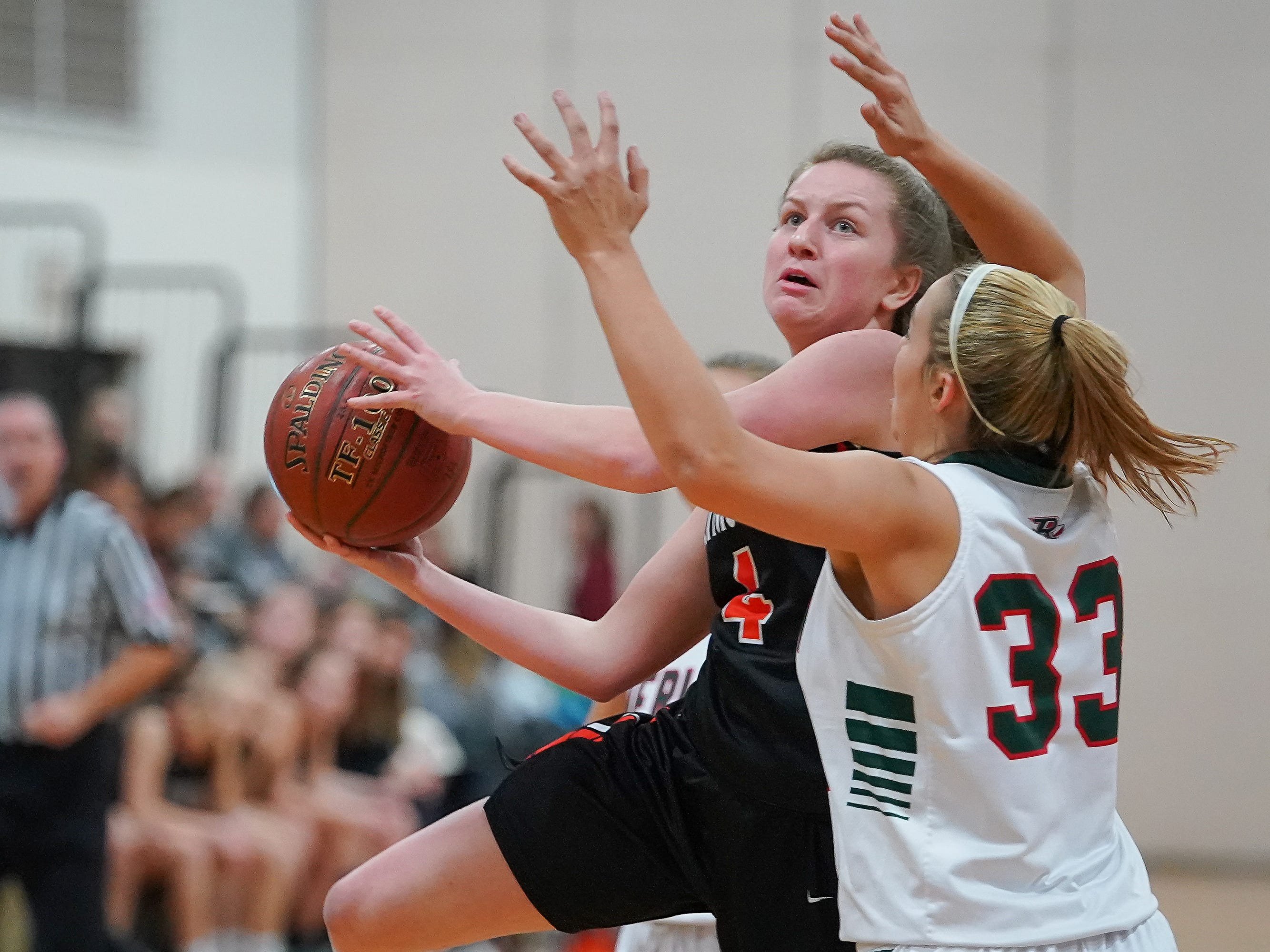 Alesha Kaat-Fohr (4) of Plymouth drives past Madalyn Naparalla (33) of Berlin. The Berlin Indians hosted the Plymouth Panthers in an East Central Conference basketball game Thursday evening, December 13, 2018.