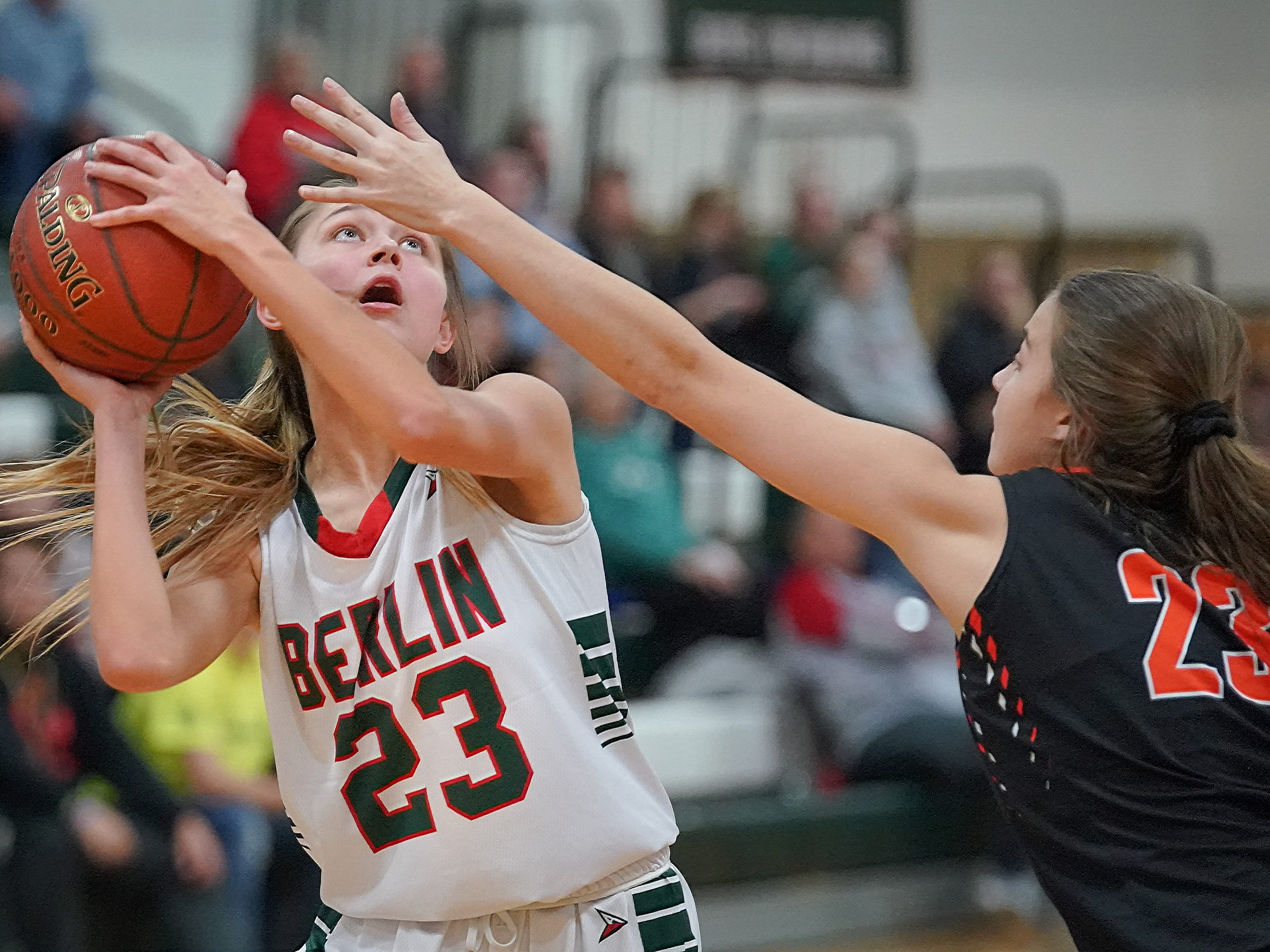 Emily Klawitter (23) of Berlin keeps her eye on the basket as she shoots. The Berlin Indians hosted the Plymouth Panthers in an East Central Conference basketball game Thursday evening, December 13, 2018.