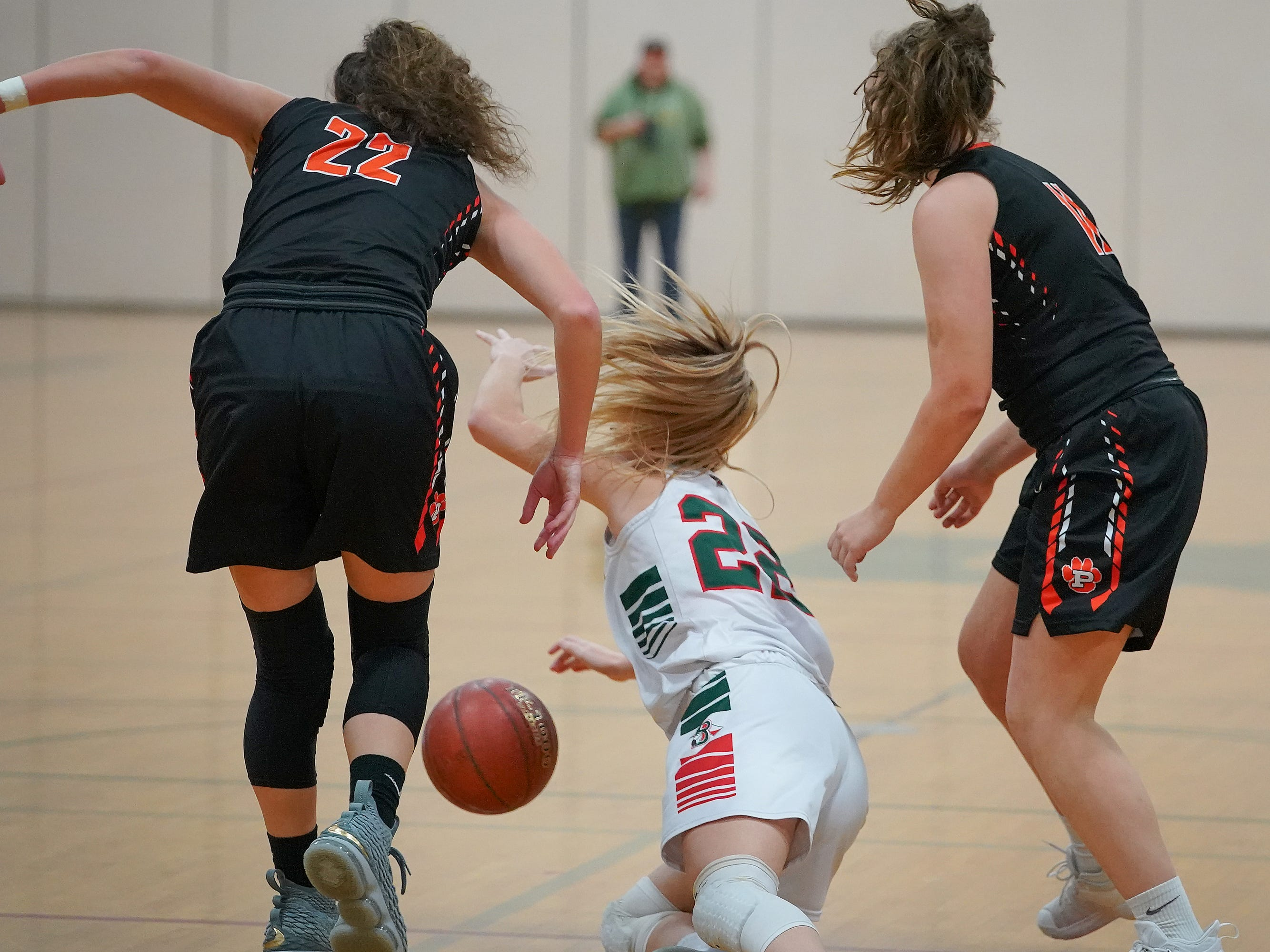 Mari Beltran (22) of Berlin falls while chasing a loose ball. The Berlin Indians hosted the Plymouth Panthers in an East Central Conference basketball game Thursday evening, December 13, 2018.