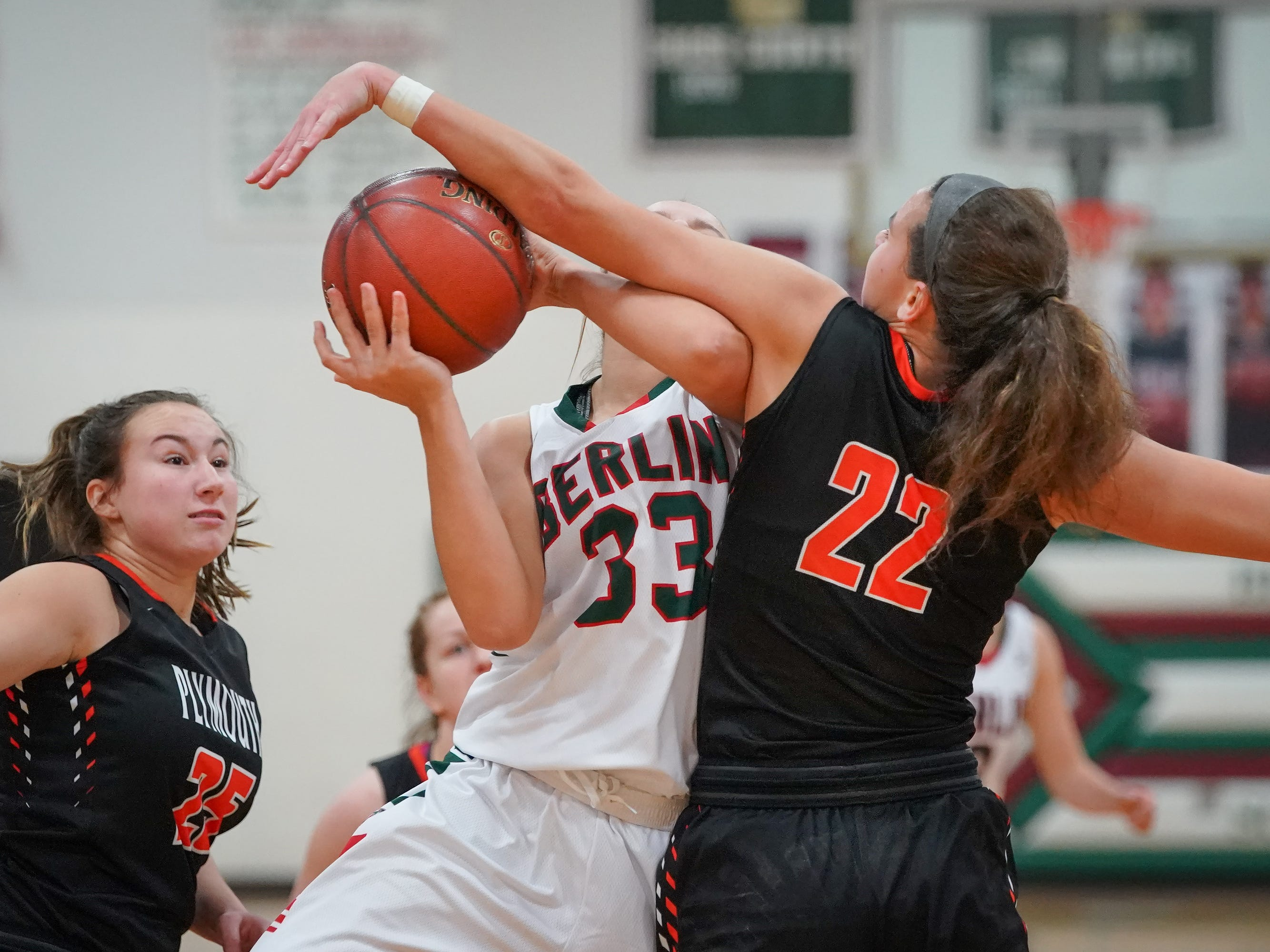 Madalyn Naparalla (33) of Berlin gets a shot blocked by Kalani Smith (22) of Plymouth. The Berlin Indians hosted the Plymouth Panthers in an East Central Conference basketball game Thursday evening, December 13, 2018.