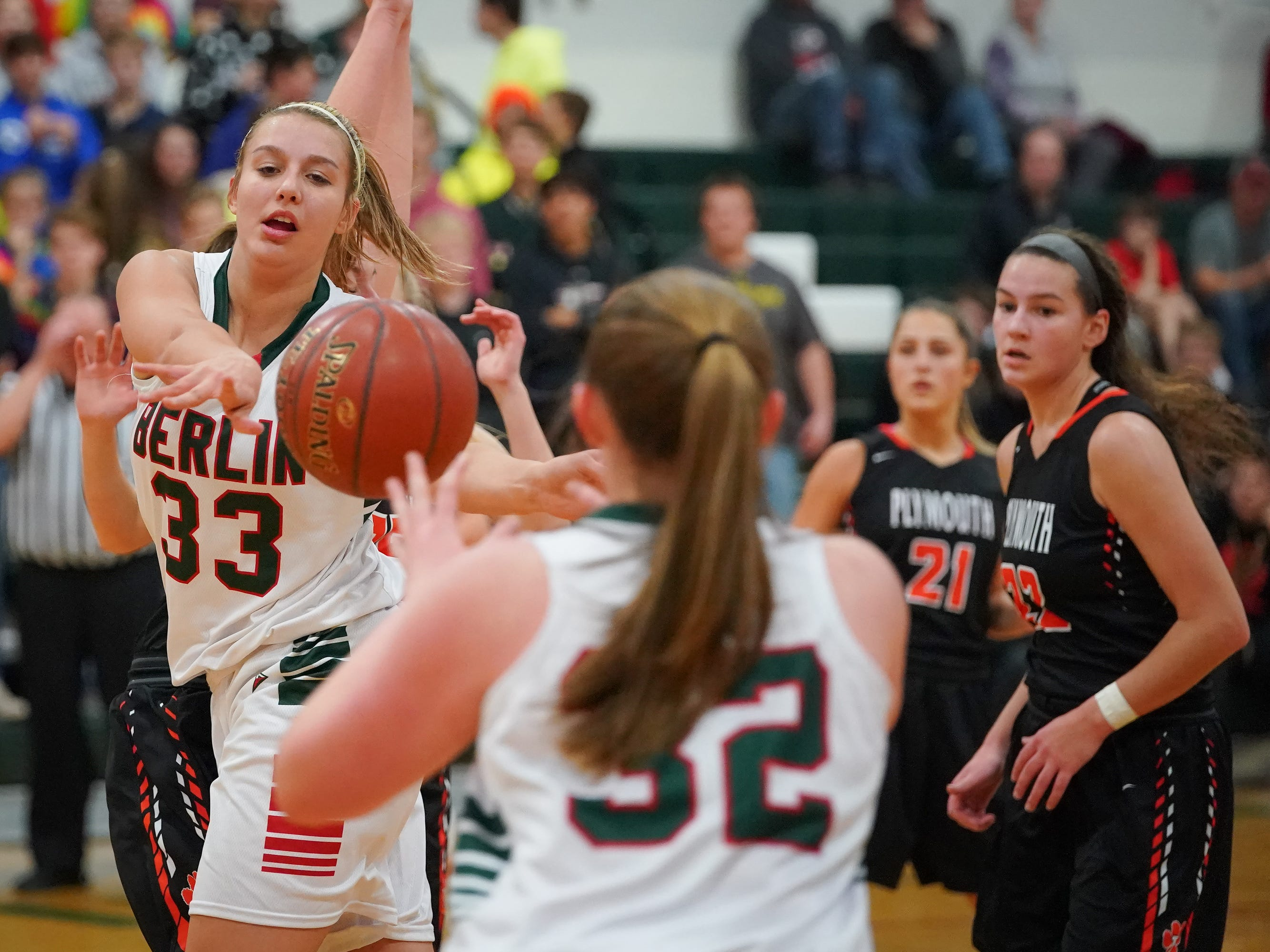 Madalyn Naparalla (33) of Berlin passes to Jenna Sternitske (32). The Berlin Indians hosted the Plymouth Panthers in an East Central Conference basketball game Thursday evening, December 13, 2018.