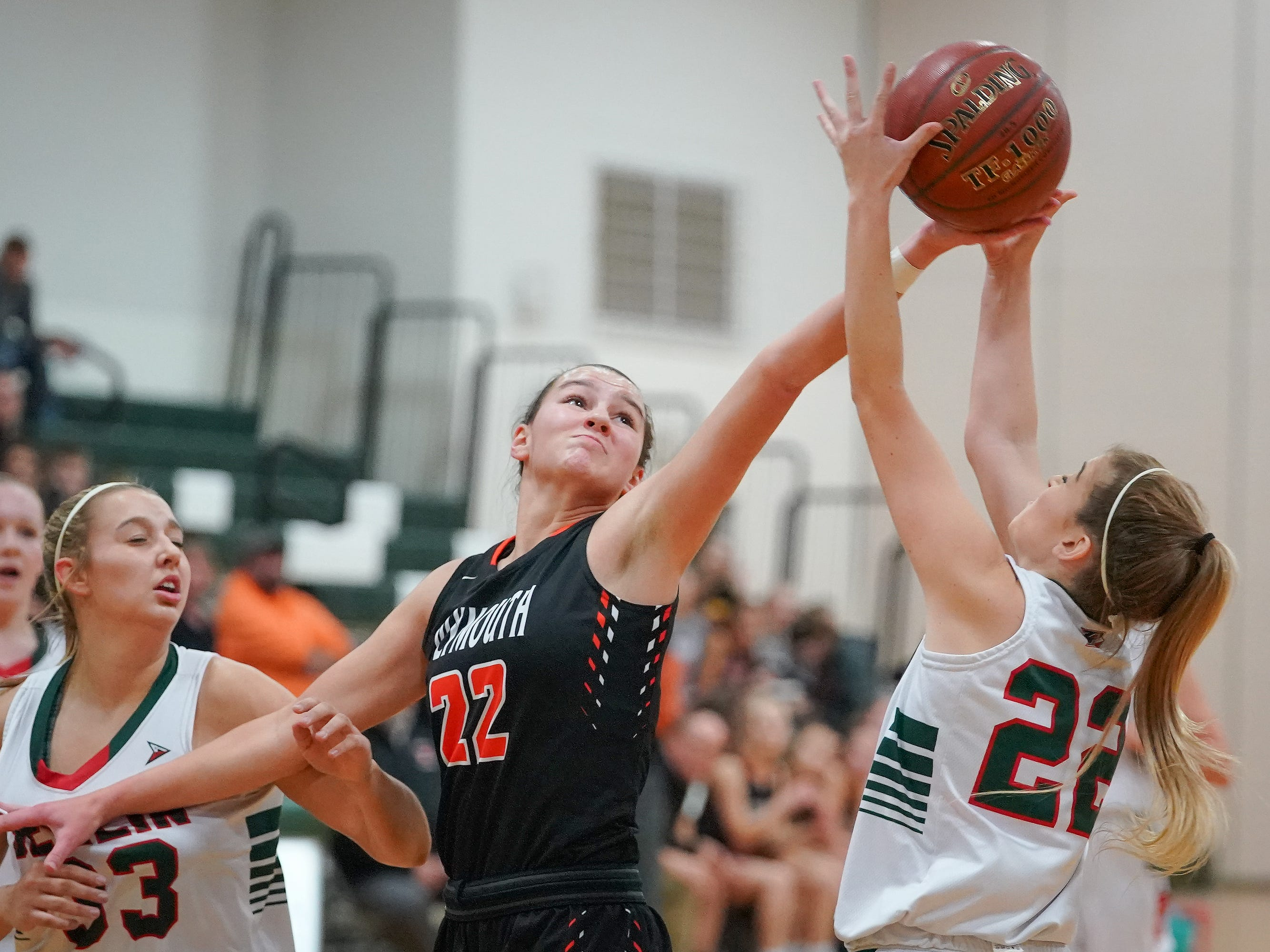Mari Beltran (22) of Berlin and Kalani Smith (22) of Plymouth battle for a rebound. The Berlin Indians hosted the Plymouth Panthers in an East Central Conference basketball game Thursday evening, December 13, 2018.