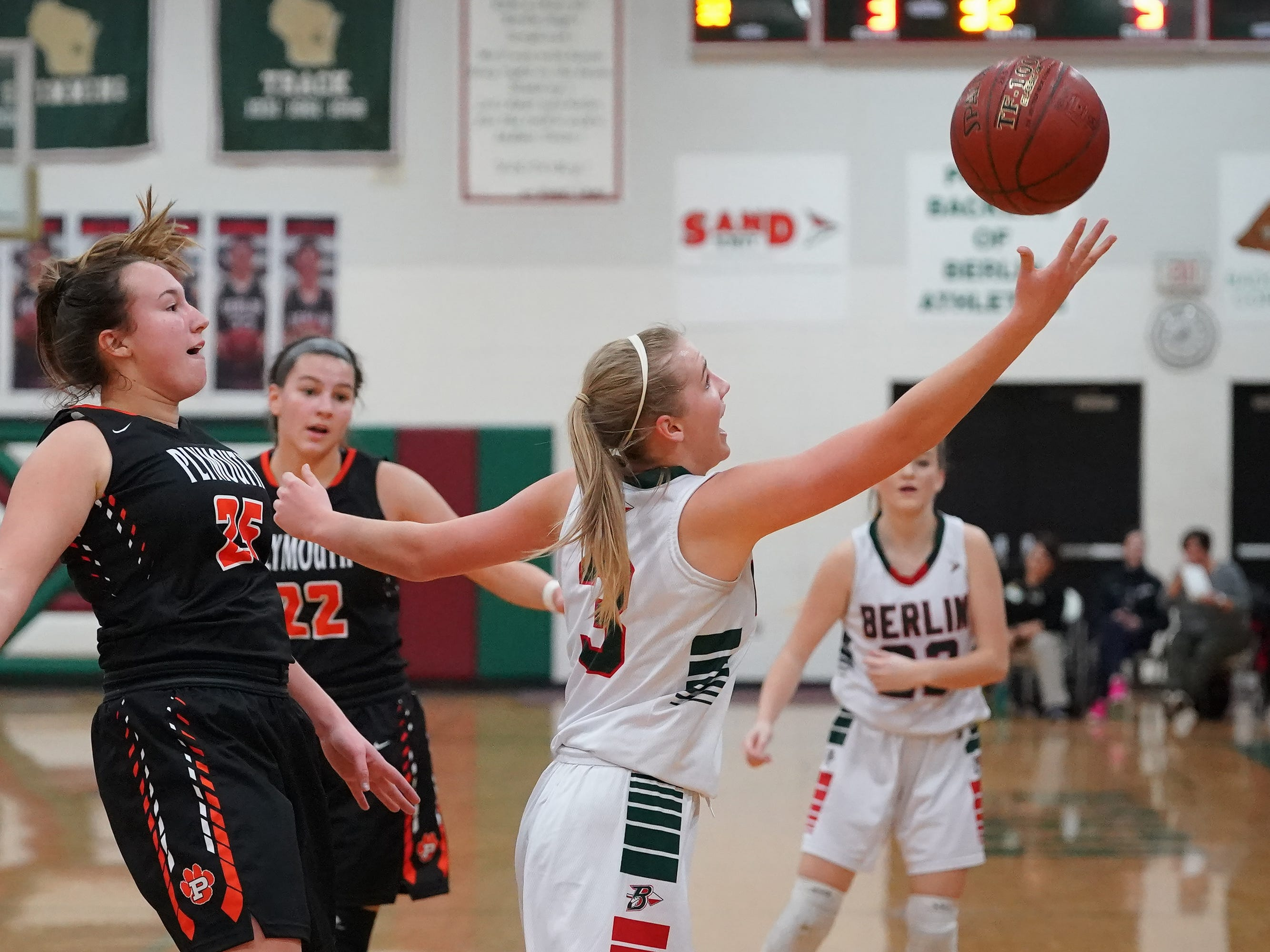Myah Jodarski (3) of Berlin stretches for a pass. The Berlin Indians hosted the Plymouth Panthers in an East Central Conference basketball game Thursday evening, December 13, 2018.