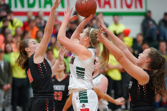 Myah Jodarski (3) of Berlin fights under the basket for a shot. The Berlin Indians hosted the Plymouth Panthers in an East Central Conference basketball game Thursday evening, December 13, 2018.