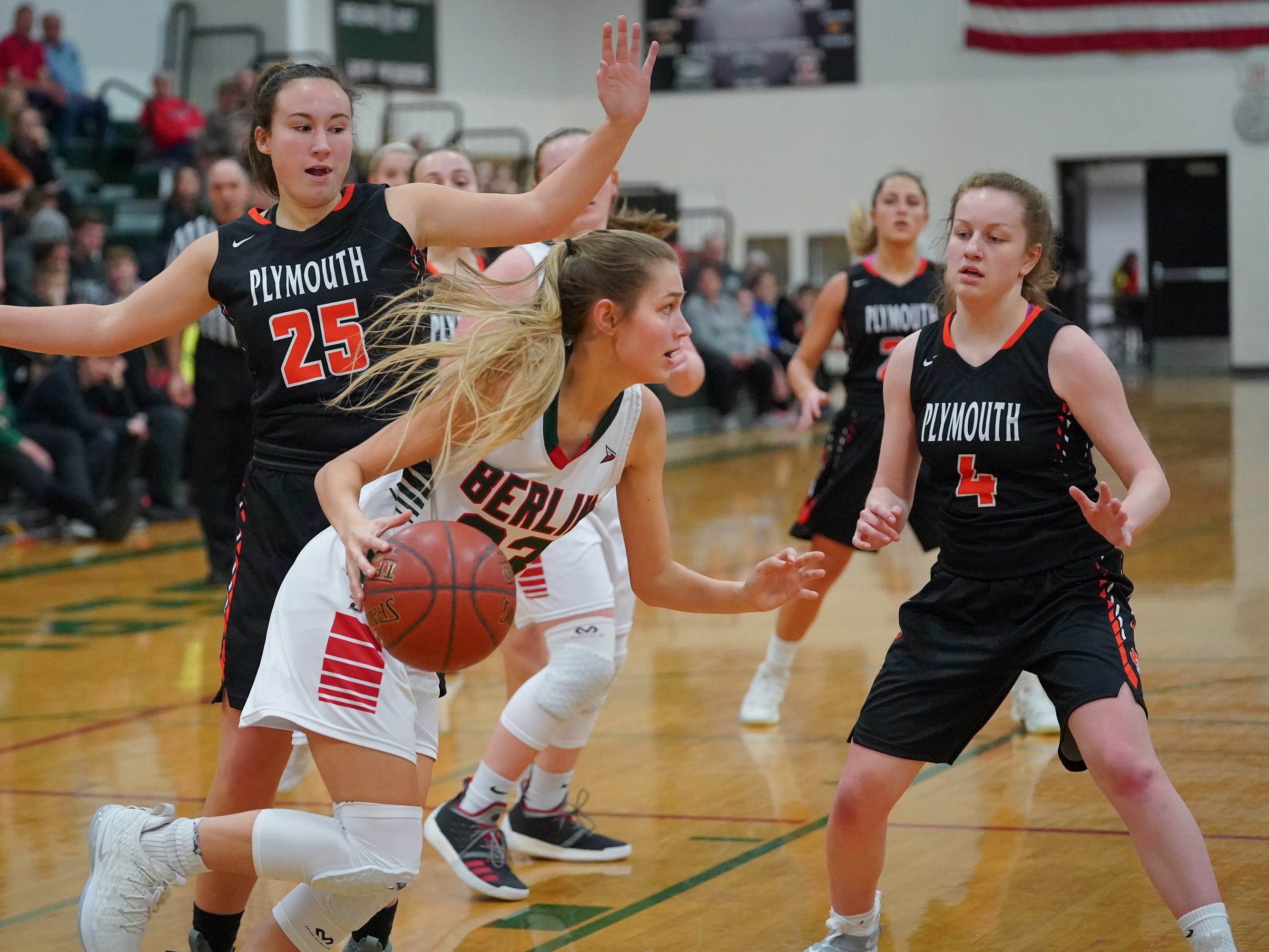 Emily Klawitter (23) of Berlin drives under the basket for a shot. The Berlin Indians hosted the Plymouth Panthers in an East Central Conference basketball game Thursday evening, December 13, 2018.