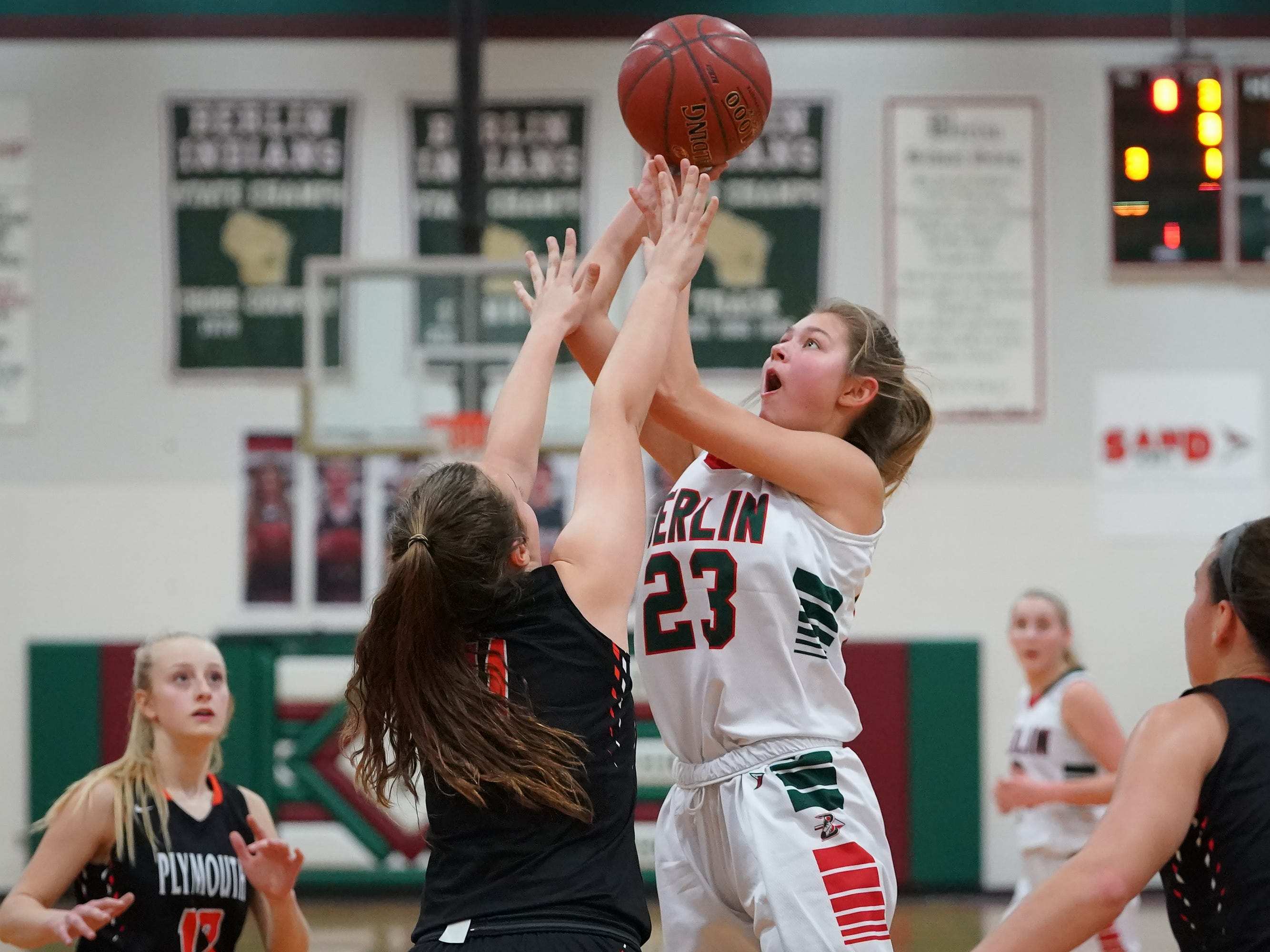 Emily Klawitter (23) of Berlin jumps for a shot. The Berlin Indians hosted the Plymouth Panthers in an East Central Conference basketball game Thursday evening, December 13, 2018.