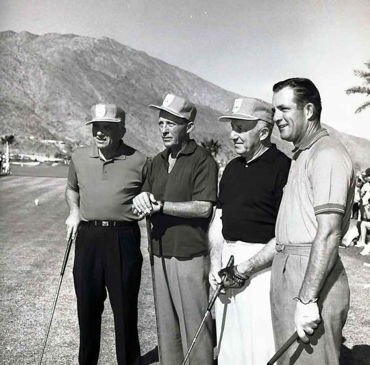 Bing Crosby and Frank Sinatra playing golf in the desert.