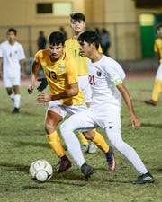 Jose Becerra attempts to steal the ball. Desert Mirage takes the win during OT against Coachella Valley.