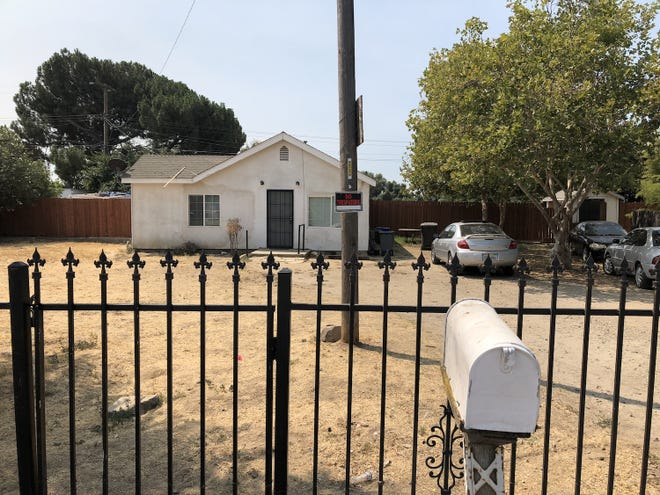 1306 Garden Avenue as it appears today. New tenants have fixed the front gate and put up the back fence.