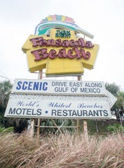 Work to take down the existing Pensacola Beach sign and replace it with a new, LED model won't start until after Labor Day weekend.