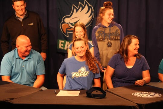 Jay High senior golf star Sarah Edwards is joined by her parents and sisters, along with her golf swing coach,  after an event at the school this week to honor her November signing with Florida Gulf Coast University in Fort Myers.
