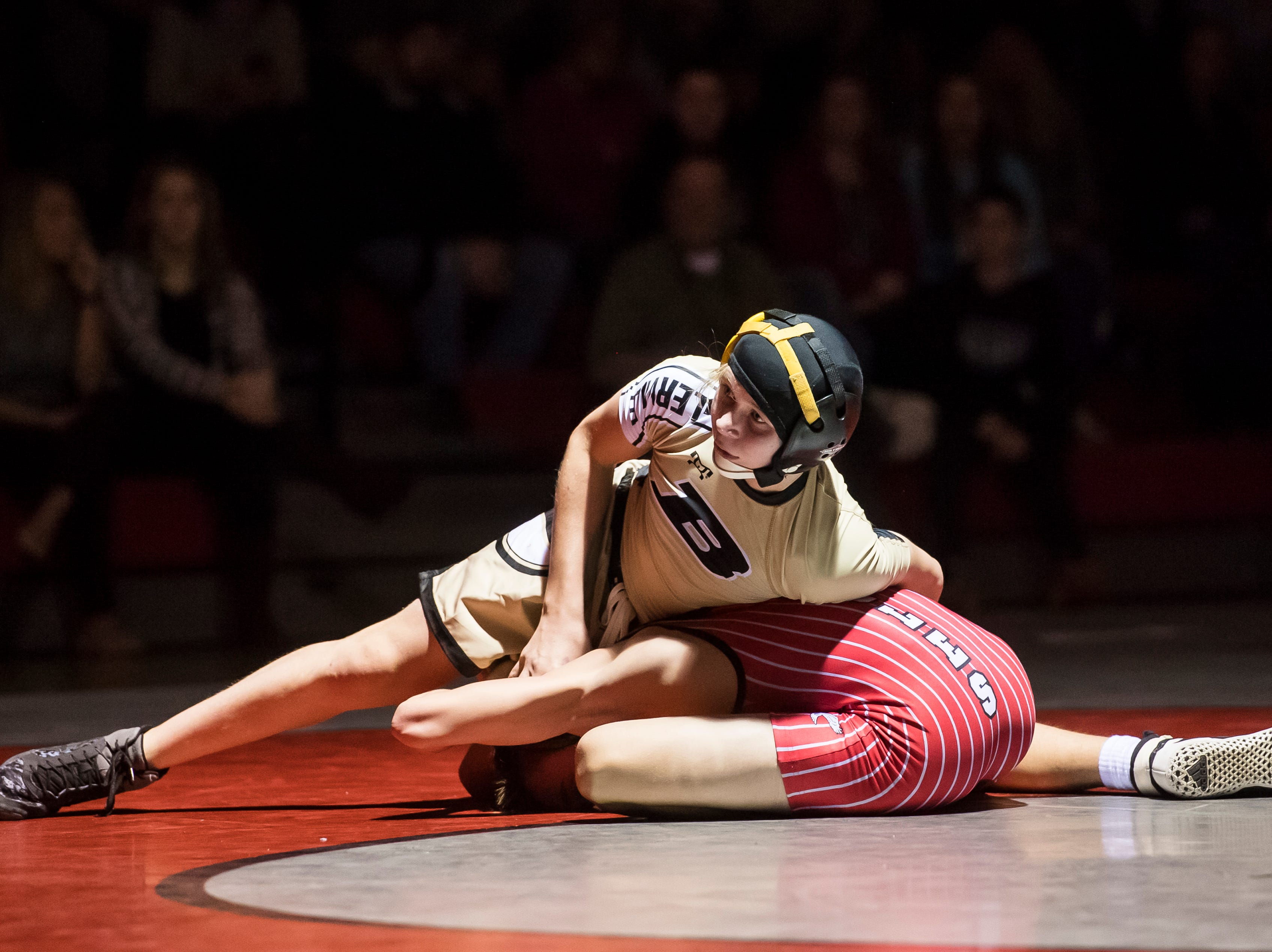 Biglerville's Ethan Slaybaugh, top, wrestles Bermudian Springs' Cole Mosier in the 113-pound bout at Bermudian Springs High School on December 13, 2018. Slabaugh won by fall in the third period but the Eagles won the duel 51-27.