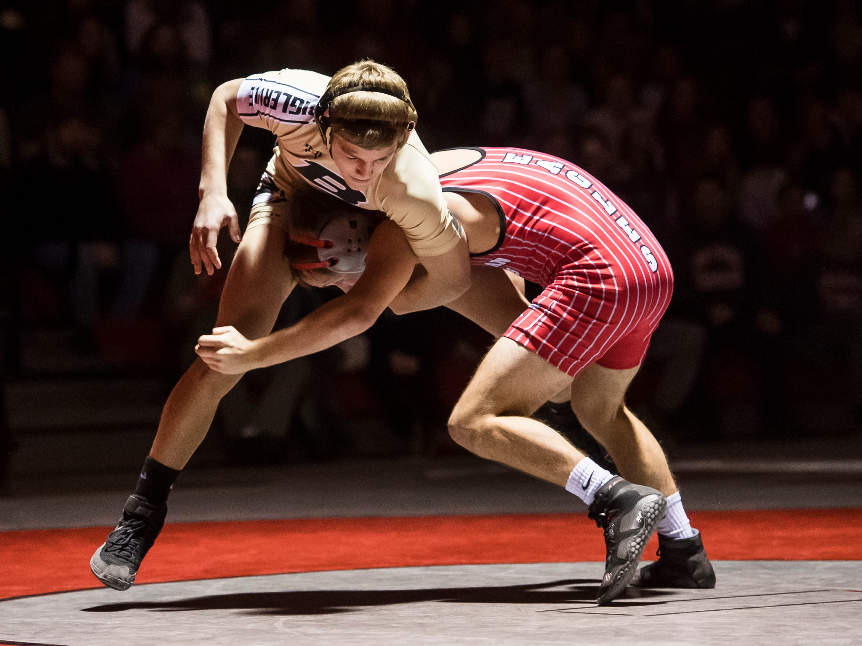 Biglerville's Blake Showers, top, wrestles Bermudian Springs' Korey Smith in the 120-pound bout at Bermudian Springs High School on December 13, 2018. Showers won by fall in the first period but the Eagles won the duel 51-27.