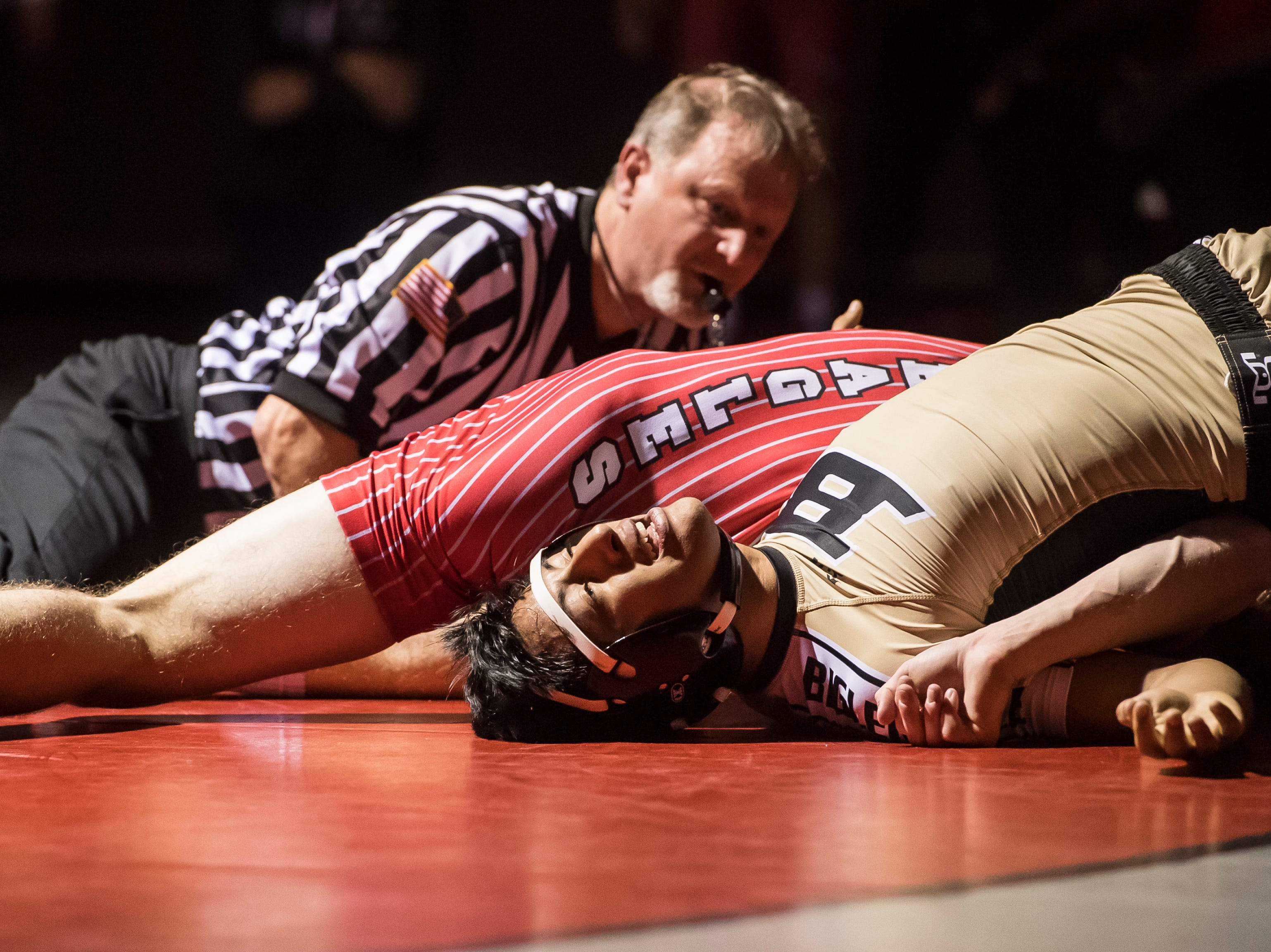 Bermudian Springs' Tanner Althoff, top, pins Biglerville's Isaac Sierra-Soto in the 152-pound bout at Bermudian Springs High School on December 13, 2018. The Eagles won the duel 51-27.