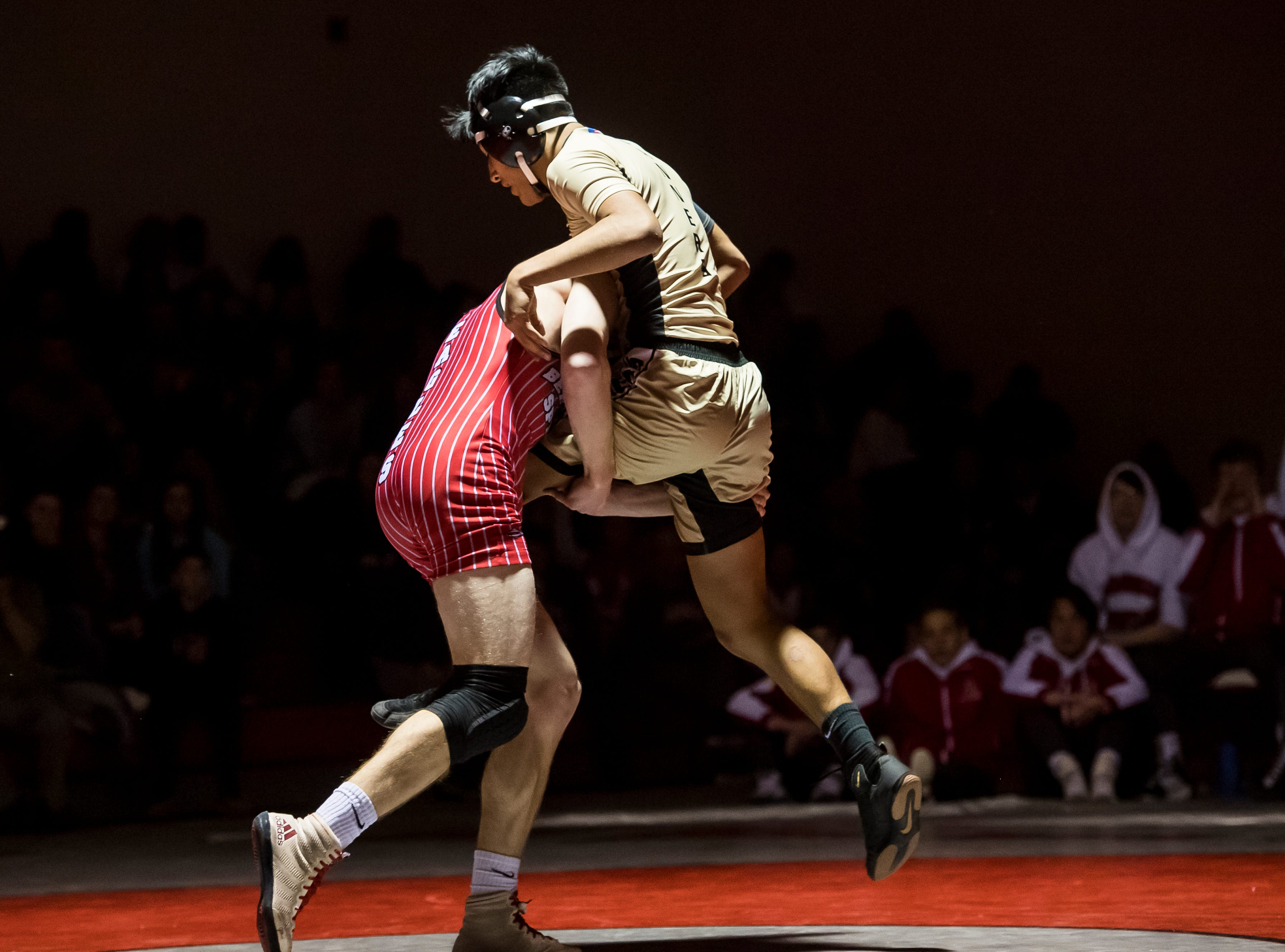 Bermudian Springs' Tanner Althoff, left, lifts up Biglerville's Isaac Sierra-Soto in the 152-pound bout at Bermudian Springs High School on December 13, 2018. Althoff won by fall and the Eagles won the duel 51-27.