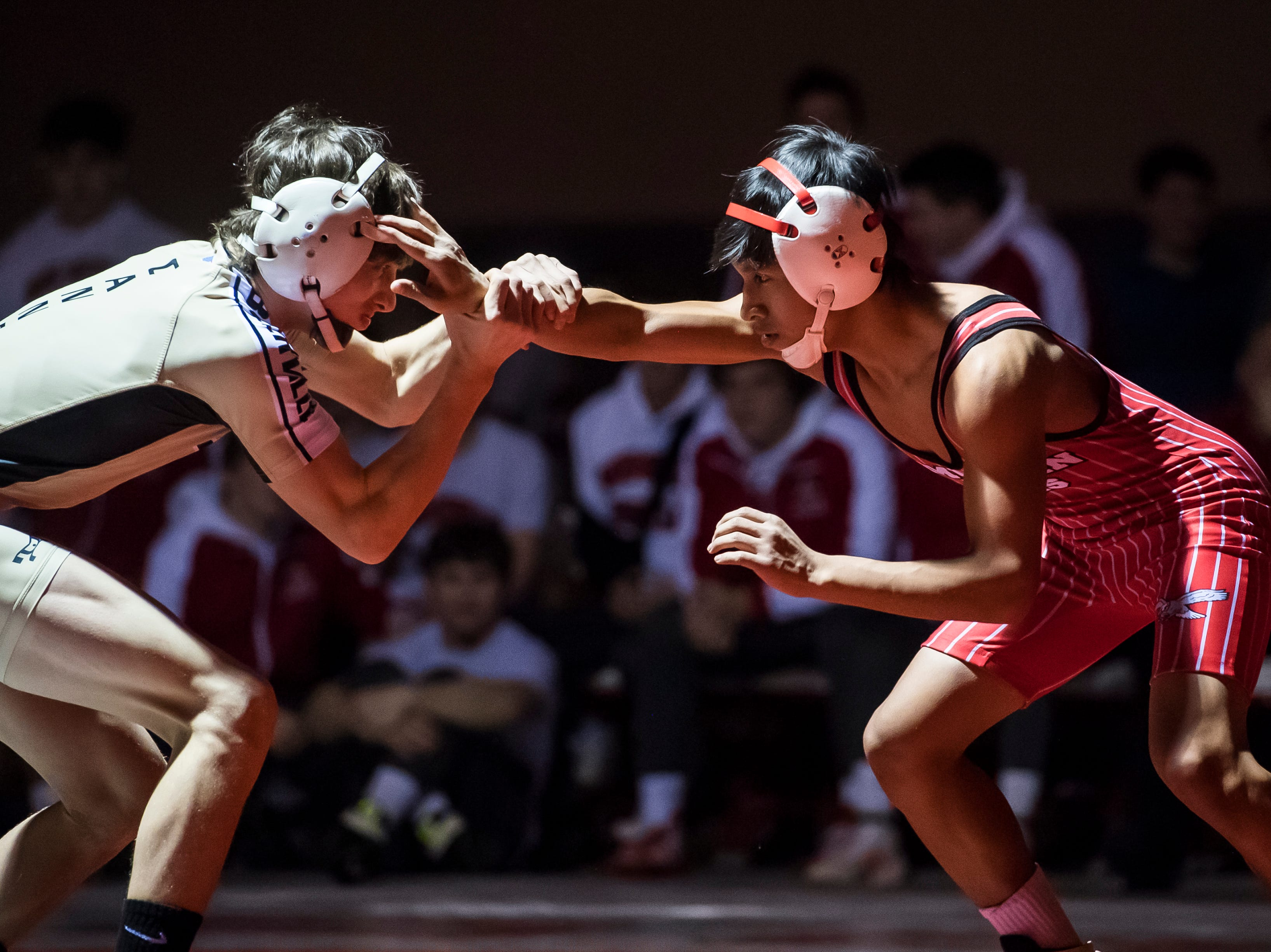 Bermudian Springs' Coby Johnston, right, wrestles Biglerville's Levi Haines in the 106-pound bout at Bermudian Springs High School on December 13, 2018. The Eagles won 51-27. Haines won by fall but the Eagles won the duel 51-27.
