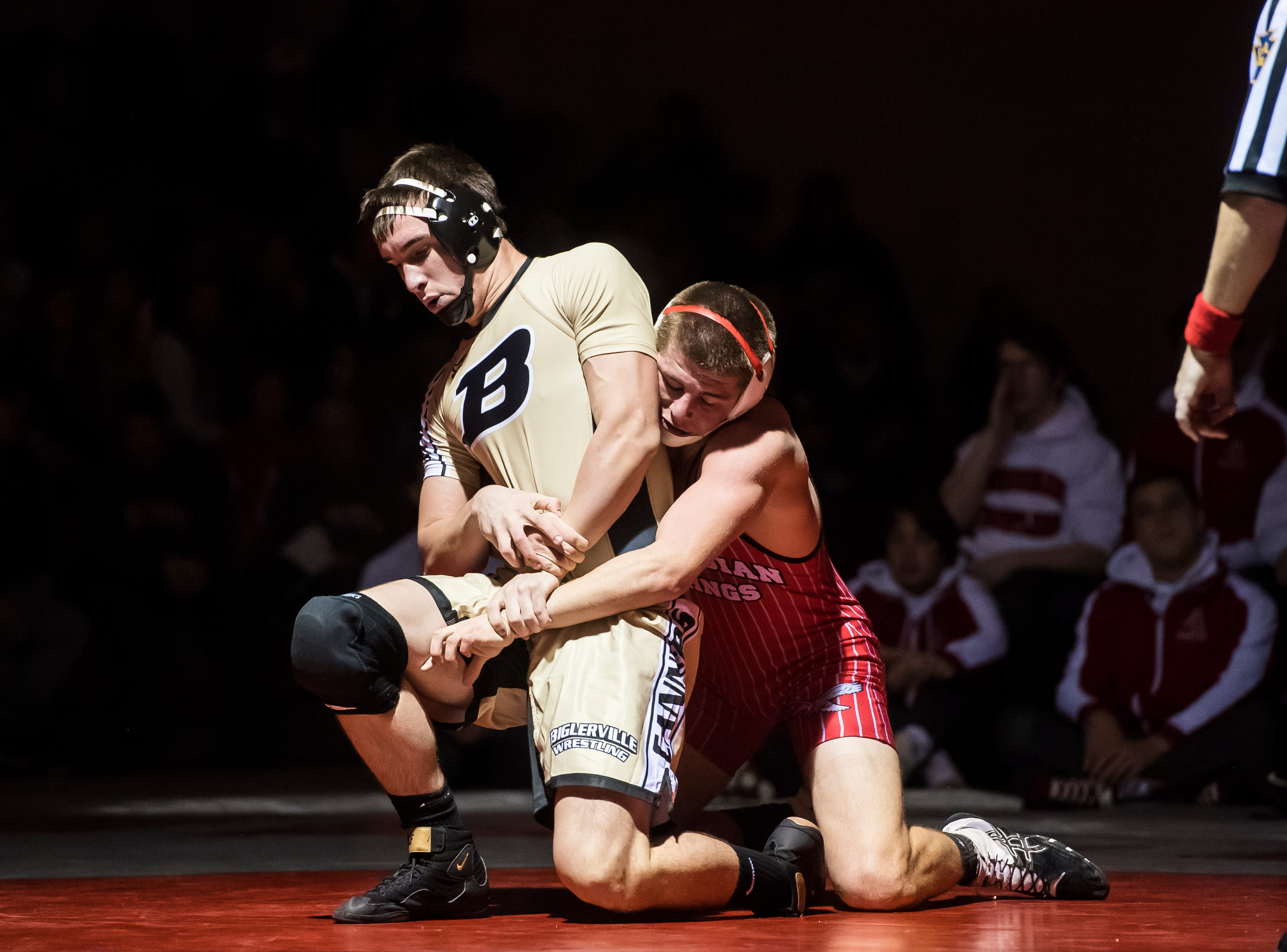 Bermudian Springs' Nate McCollum, right, wrestles Biglerville's Nick Wright in the 195-pound bout at Bermudian Springs High School on December 13, 2018. McCollum won by fall and the Eagles won, 51-27.