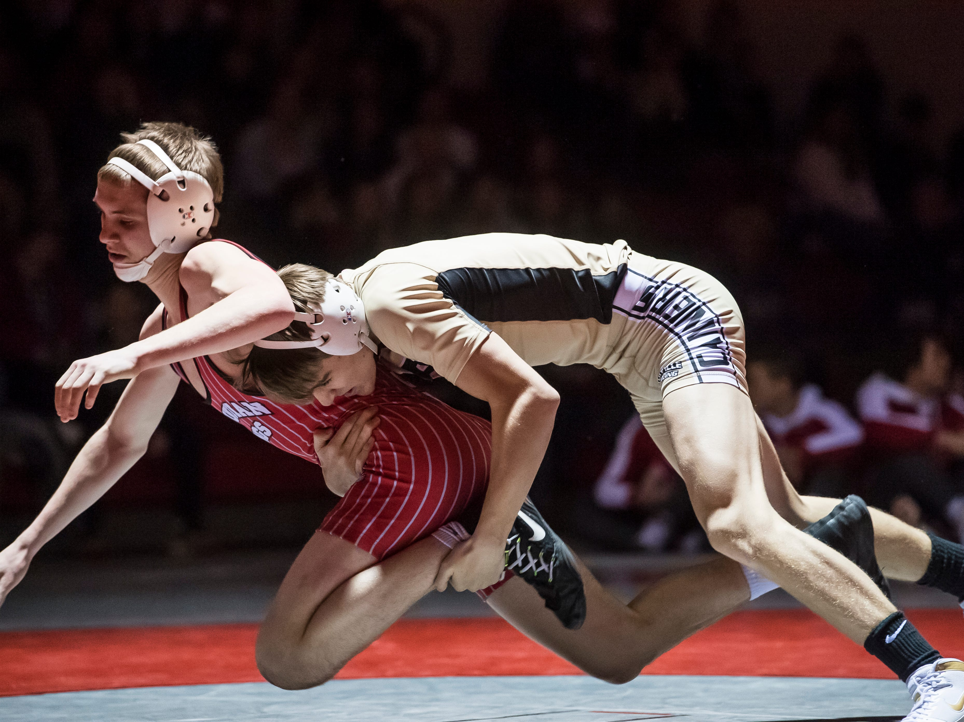 Bermudian Springs' Tyler Rawson, left, wrestles Biglerville's Joshua Tuckey in the 132-pound bout at Bermudian Springs High School on December 13, 2018. Tuckey won 6-5 but the Eagles won, 51-27.