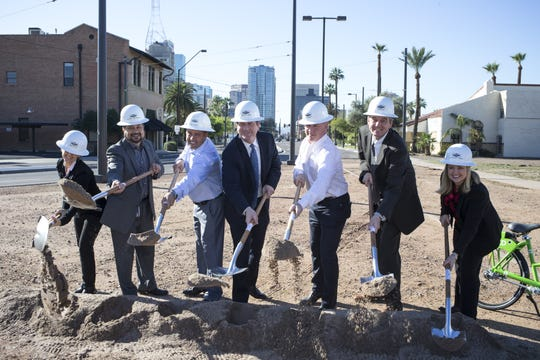 Shannon Scutari with Sustainable Communities Collaborative (from left), Councilman Michael Nowakowski, Matt Seaman of Metrowest Development, Mayor Greg Stanton, Douglas Gannett of Metrowest Development, Patrick McNamara of LISC and Councilwoman Kate Gallego break ground March 4, 2015, for Union @ Roosevelt in Phoenix.
