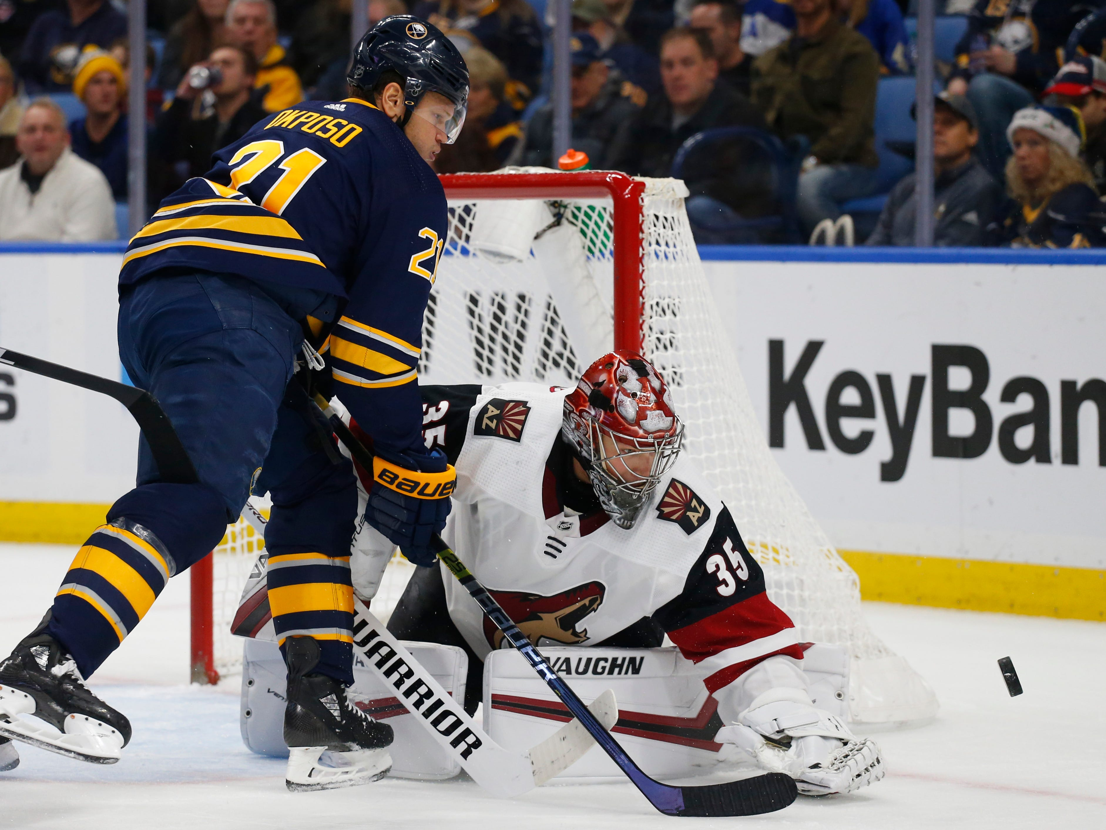 Buffalo Sabres forward Kyle Okposo (21) is stopped by Arizona Coyotes goalie Darcy Kuemper (35) during the first period of an NHL hockey game, Thursday, Dec. 13, 2018, in Buffalo N.Y. (AP Photo/Jeffrey T. Barnes)