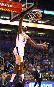 Phoenix Suns forward Trevor Ariza slam-dunks the ball against the Dallas Mavericks during a game on Dec. 13 at Talking Stick Resort Arena.