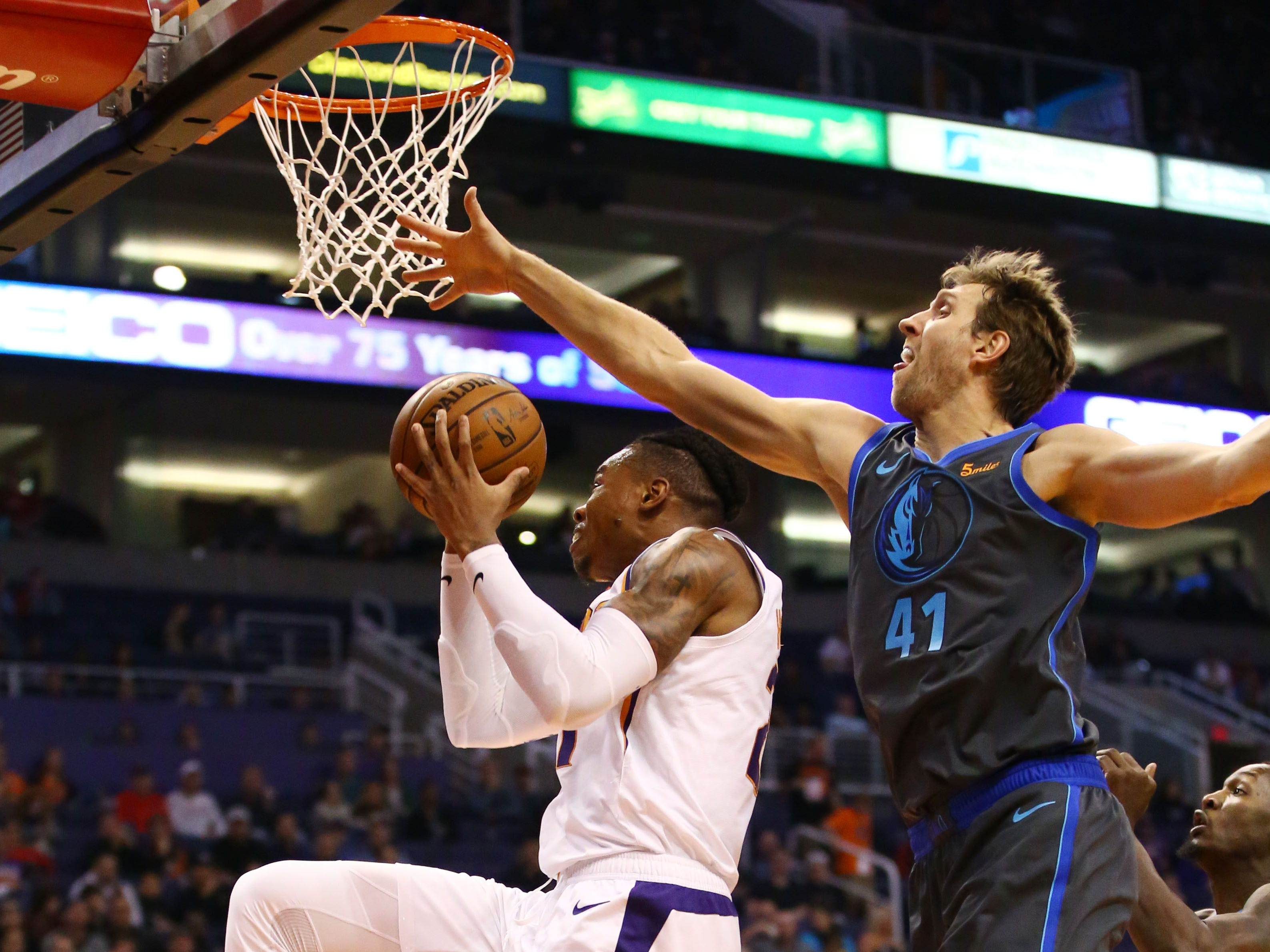 Phoenix Suns forward Richaun Holmes is pressured by Dallas Mavericks' Dirk Nowitzki during a game on Dec. 13 at Talking Stick Resort Arena.