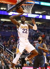 Phoenix Suns center Deandre Ayton can't control the ball under the basket against the Dallas Mavericks during a game on Dec. 13 at Talking Stick Resort Arena.
