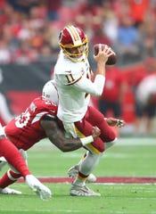 Washington Redskins QB Alex Smith is tackled by Arizona Cardinals linebacker Deone Bucannon on Sept. 9, 2018.