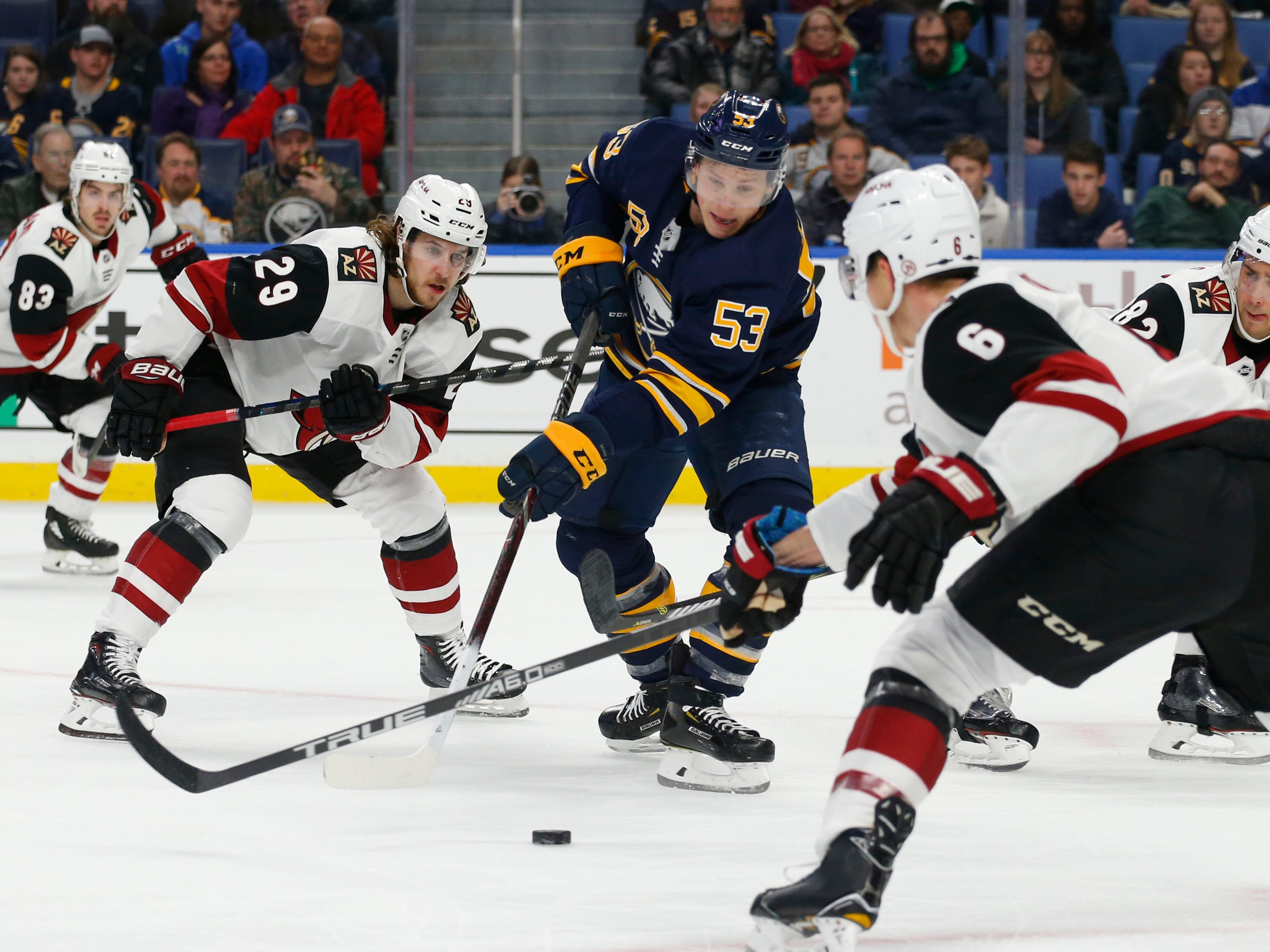 Buffalo Sabres forward Jeff Skinner (53) carries the puck past Arizona Coyotes forward Mario Kempe (29) during the first period of an NHL hockey game, Thursday, Dec. 13, 2018, in Buffalo N.Y. (AP Photo/Jeffrey T. Barnes)