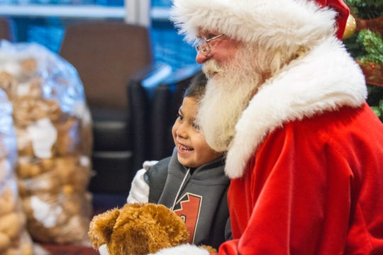 Children meet Santa during the Arizona Diamondbacks annual Winter Classic Holiday Party inside Chase Field in Phoenix, Arizona on Friday, Dec. 14, 2018.